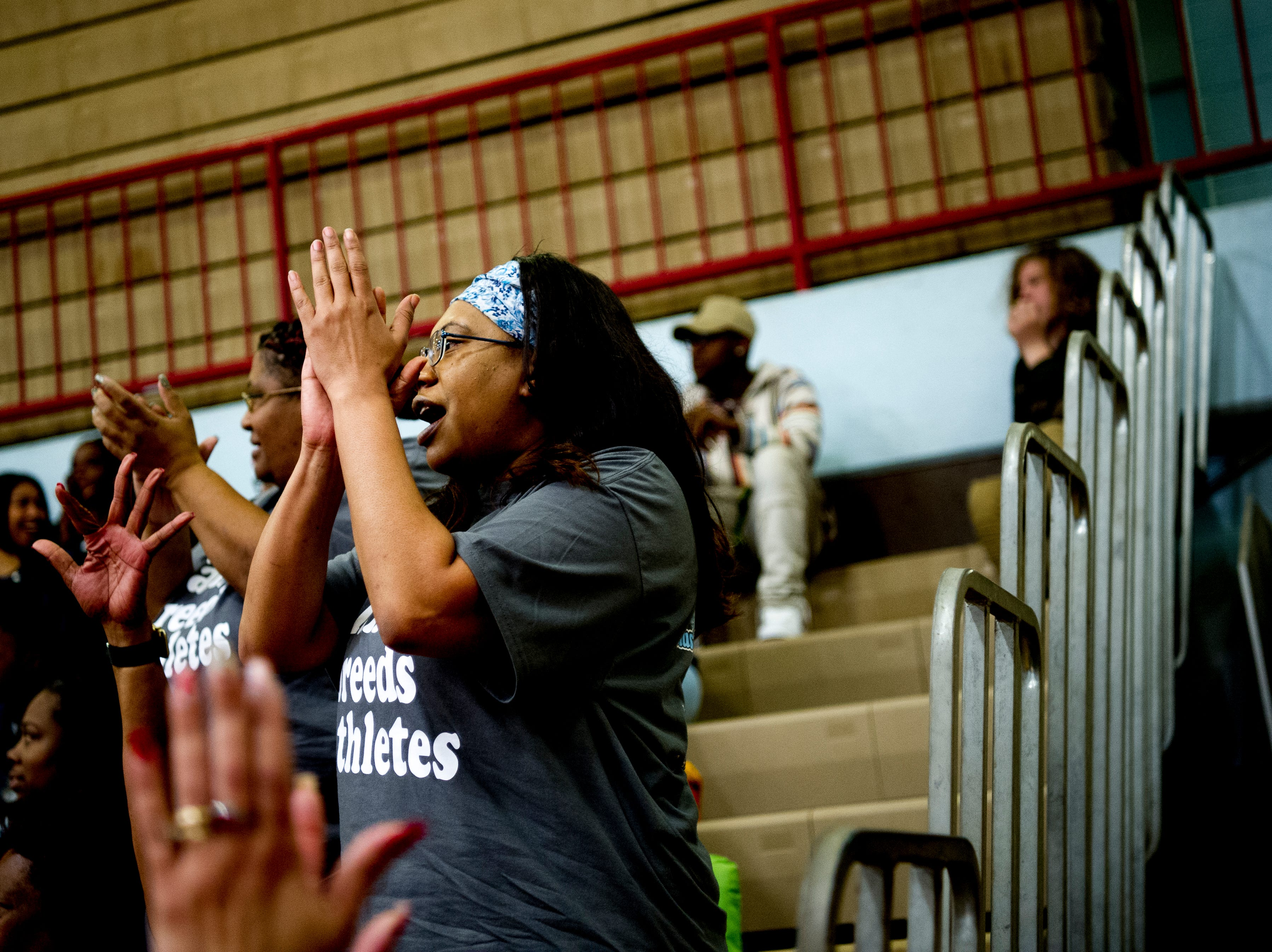 Fans cheer in the stands during a game between Austin-East and Fulton at Austin-East High School in Knoxville, Tennessee on Saturday, January 5, 2019.