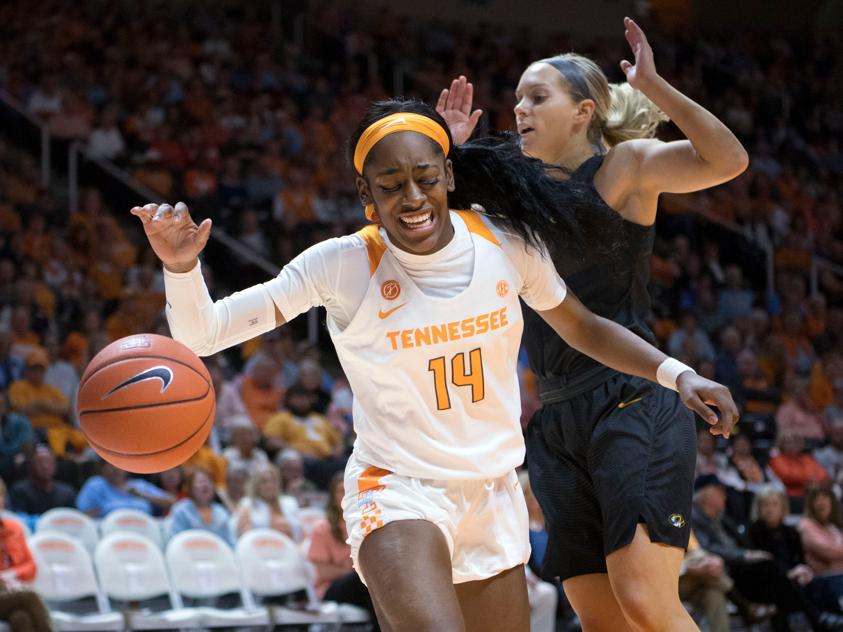 Tennessee's Zaay Green (14) loses the ball while defended by Missouri's Lauren Aldridge (5) at Thompson-Boling Arena on Sunday, January 6, 2019.