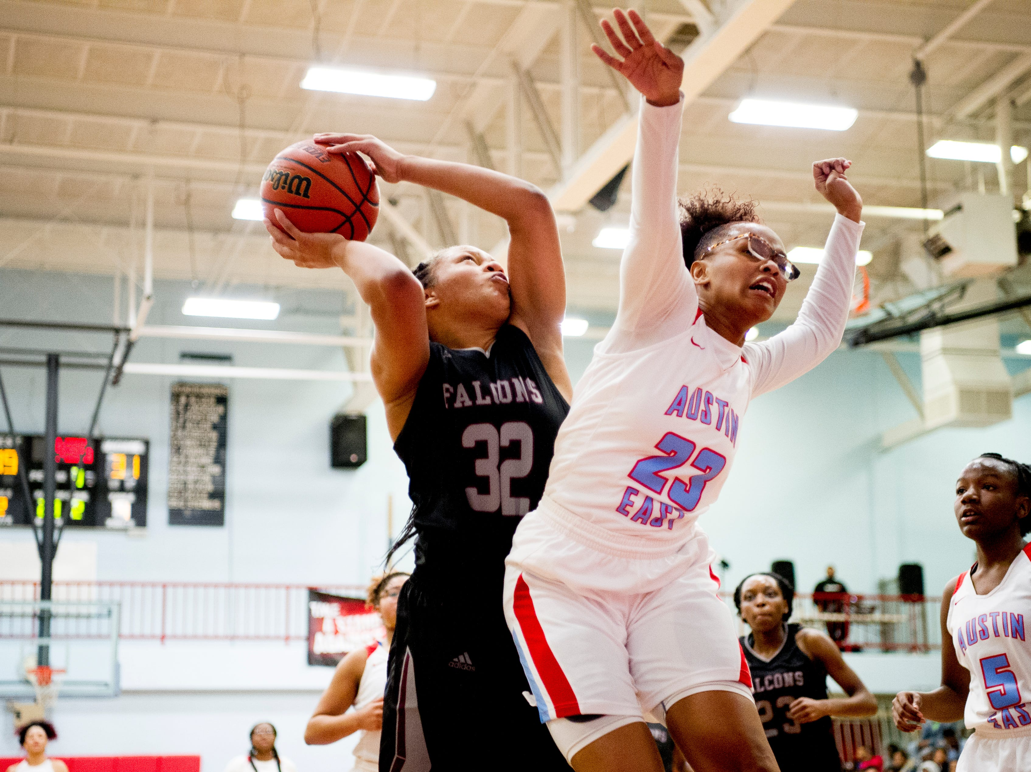 Fulton's Ranaisna Gates (32) tries to shoot past Austin-East's Camiah Wilson (23) during a game between Austin-East and Fulton at Austin-East High School in Knoxville, Tennessee on Saturday, January 5, 2019.