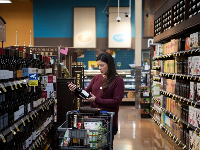 Erica Phillips shops for wine at the Kroger Marketplace in Farragut on Sunday, Jan. 6. Grocery stores can now sell wine on Sundays and most holidays.