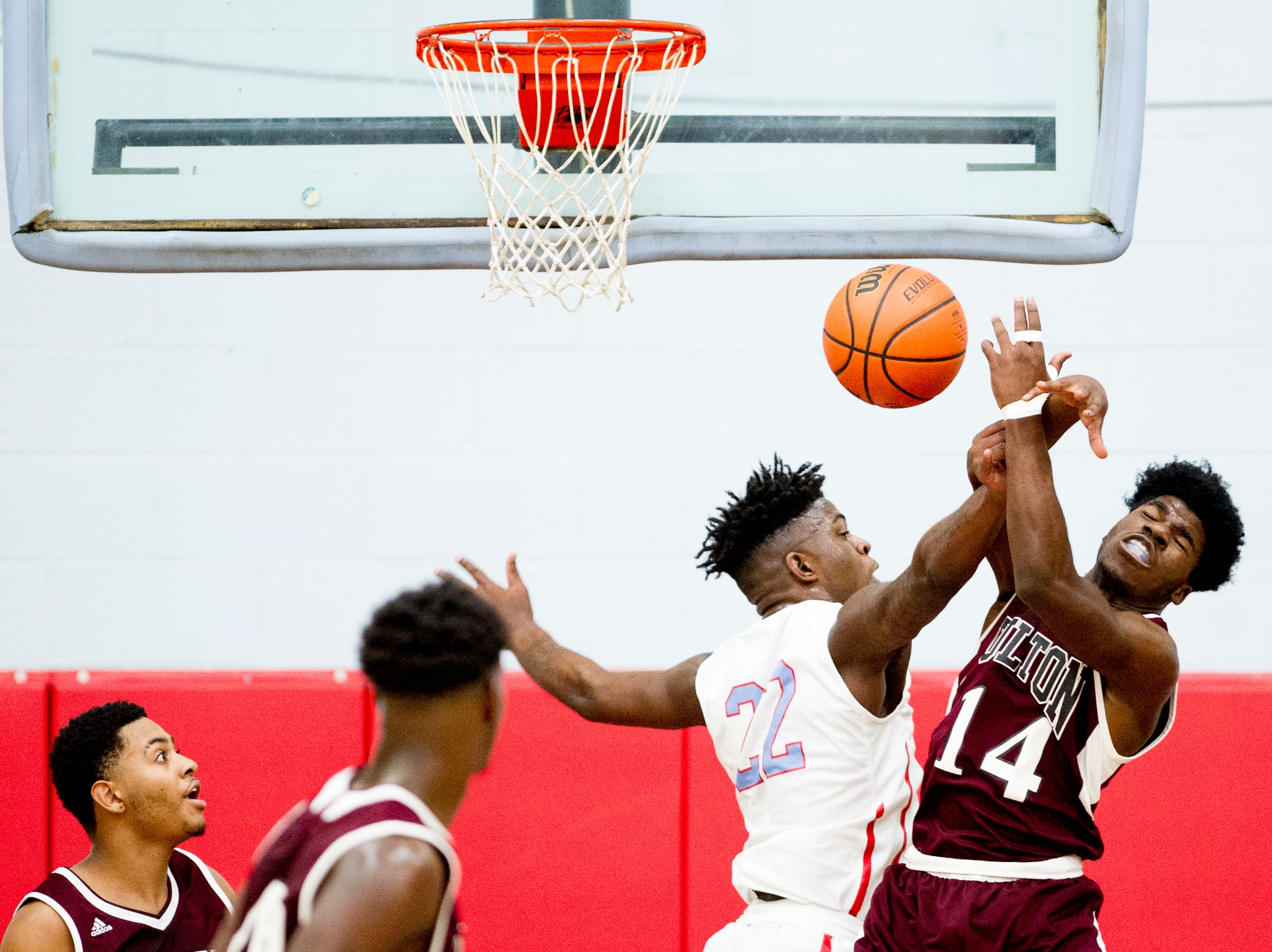 Fulton's Keith Foster (14) is knocked the ball from his hands by Austin-East's Dereke Upton (22) during a game between Austin-East and Fulton at Austin-East High School in Knoxville, Tennessee on Saturday, January 5, 2019.