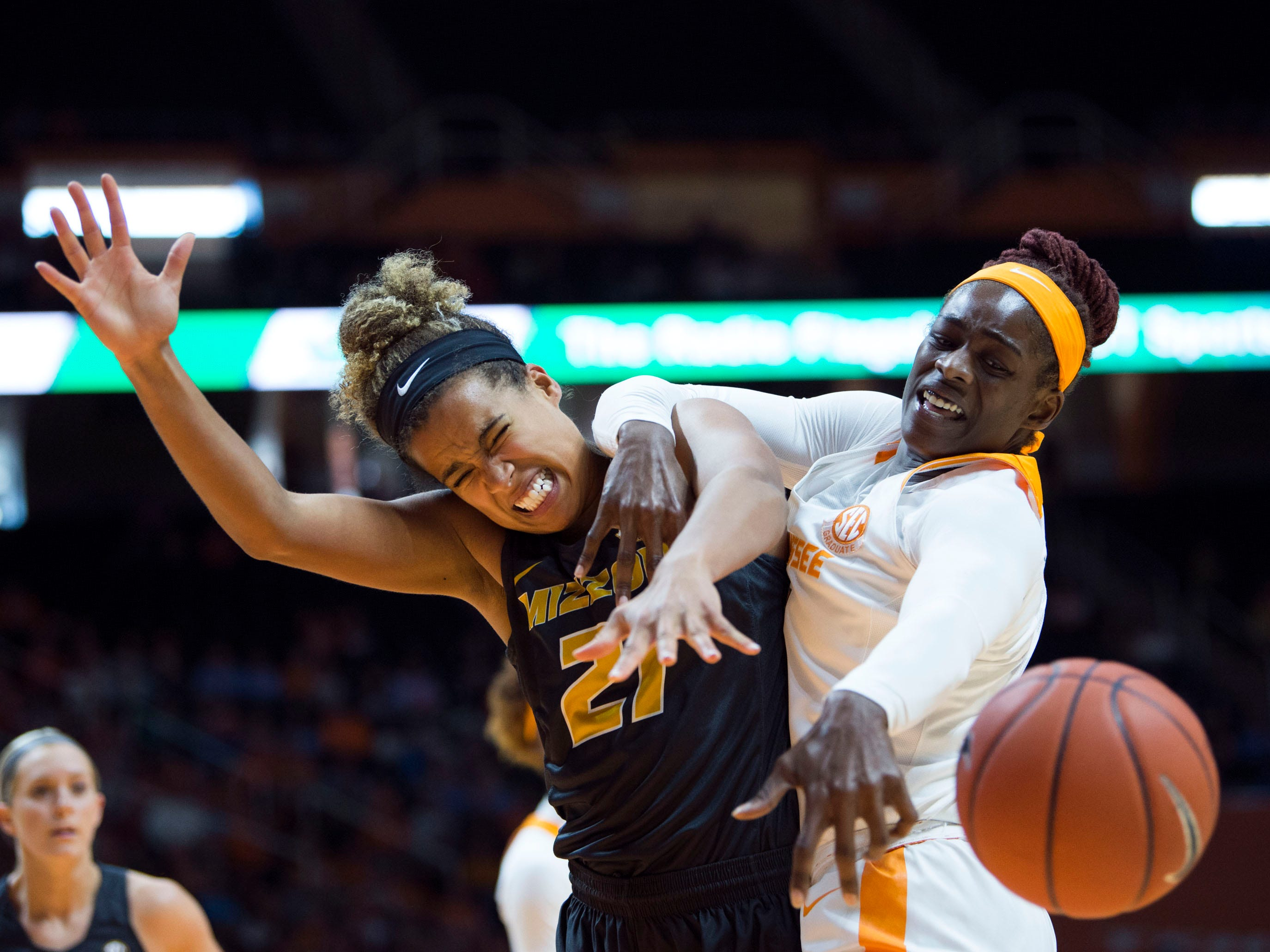 Tennessee's Cheridene Green (15) and Missouri's Cierra Porter (21) batte for the rebound on Sunday, January 6, 2019.