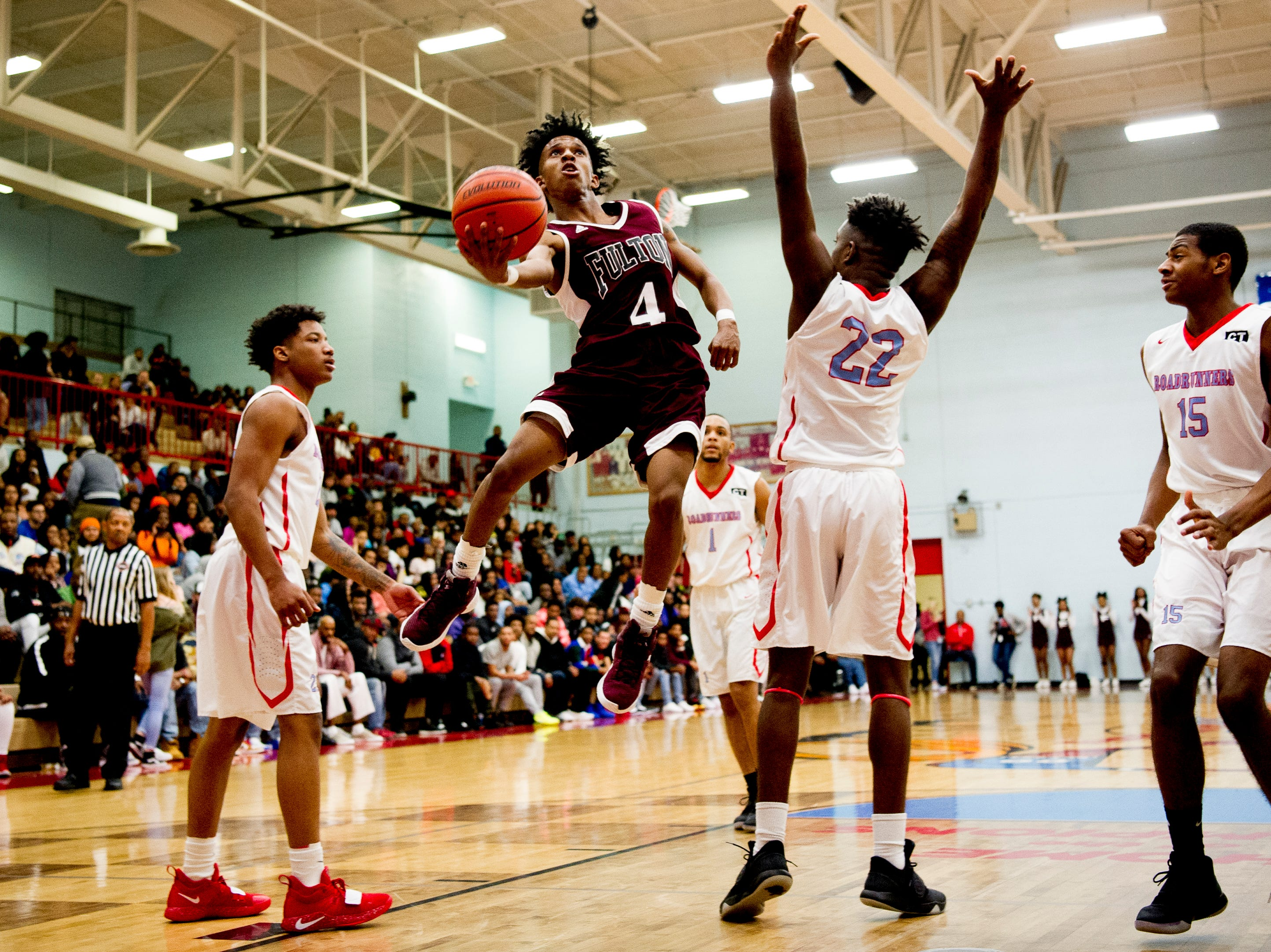 Fulton's Edward Lacy (4) shoots a layup during a game between Austin-East and Fulton at Austin-East High School in Knoxville, Tennessee on Saturday, January 5, 2019.