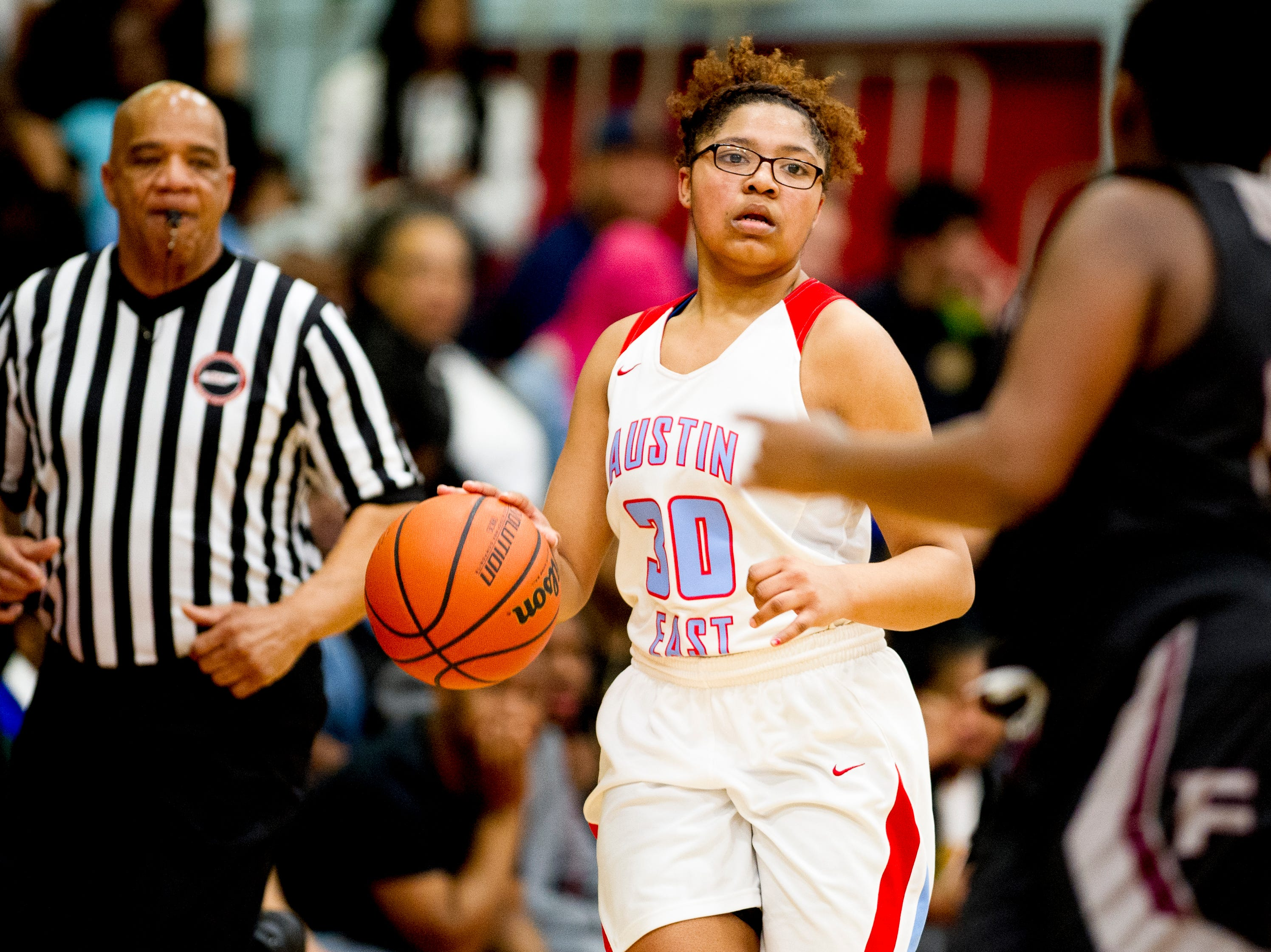 Austin-East's AnDaja Ware (30) dribbles down the court during a game between Austin-East and Fulton at Austin-East High School in Knoxville, Tennessee on Saturday, January 5, 2019.