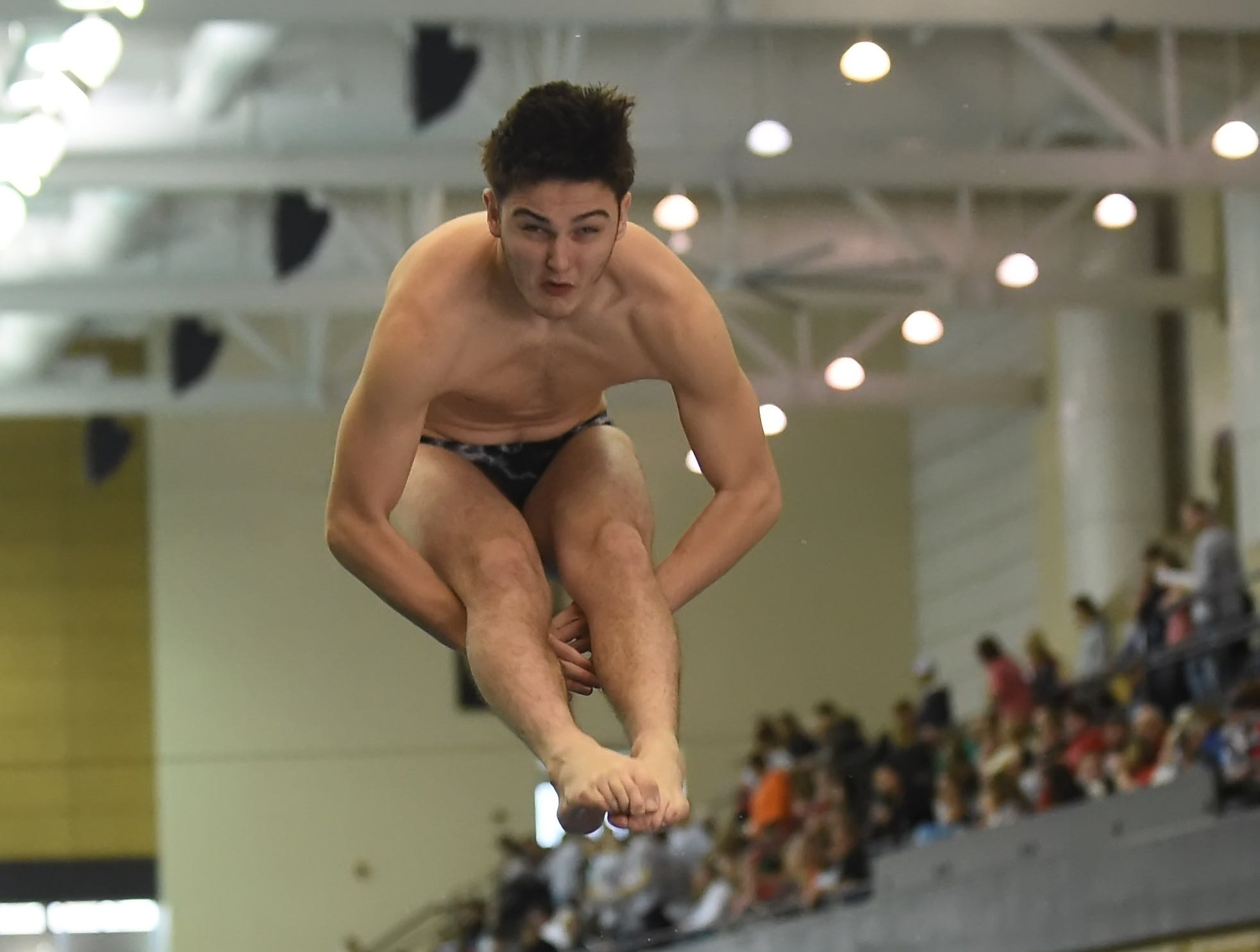 Lafayette Jeff junior Claton Vandervate dives Saturday in the North Central Conference Swimming and Diving Championships at Purdue.