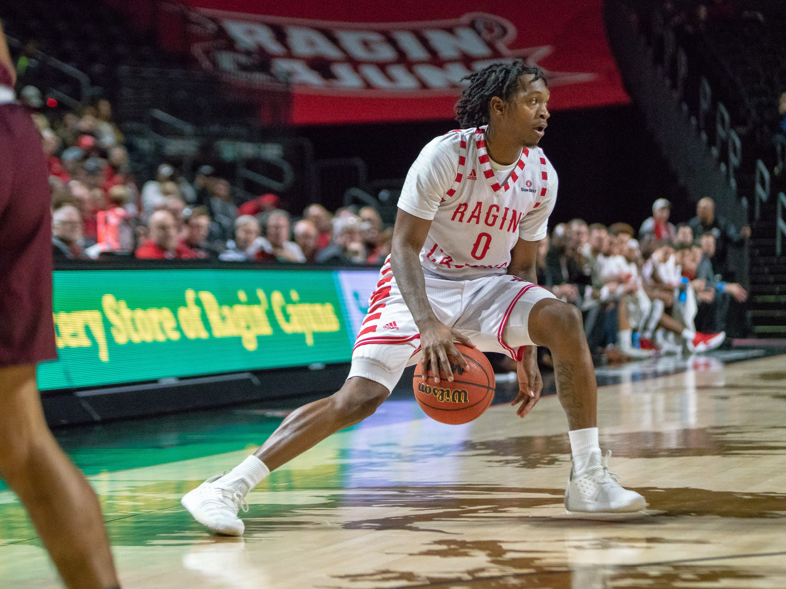 UL's Cedric Russell dribbles the ball during the play as the Ragin' Cajuns take on the Little Rock Trojans at the Cajundome on January 5, 2019.