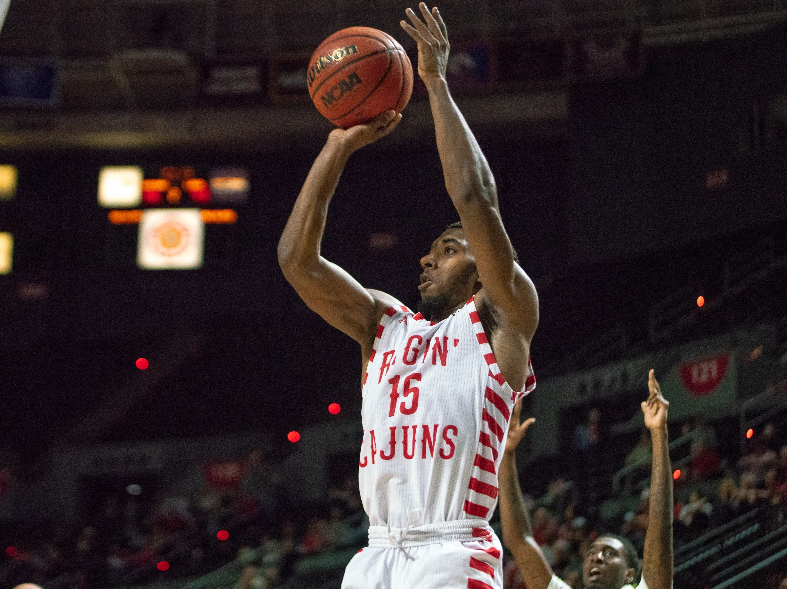 UL's P.J. Hardy shoots to score during the play as the Ragin' Cajuns take on the Little Rock Trojans at the Cajundome on January 5, 2019.