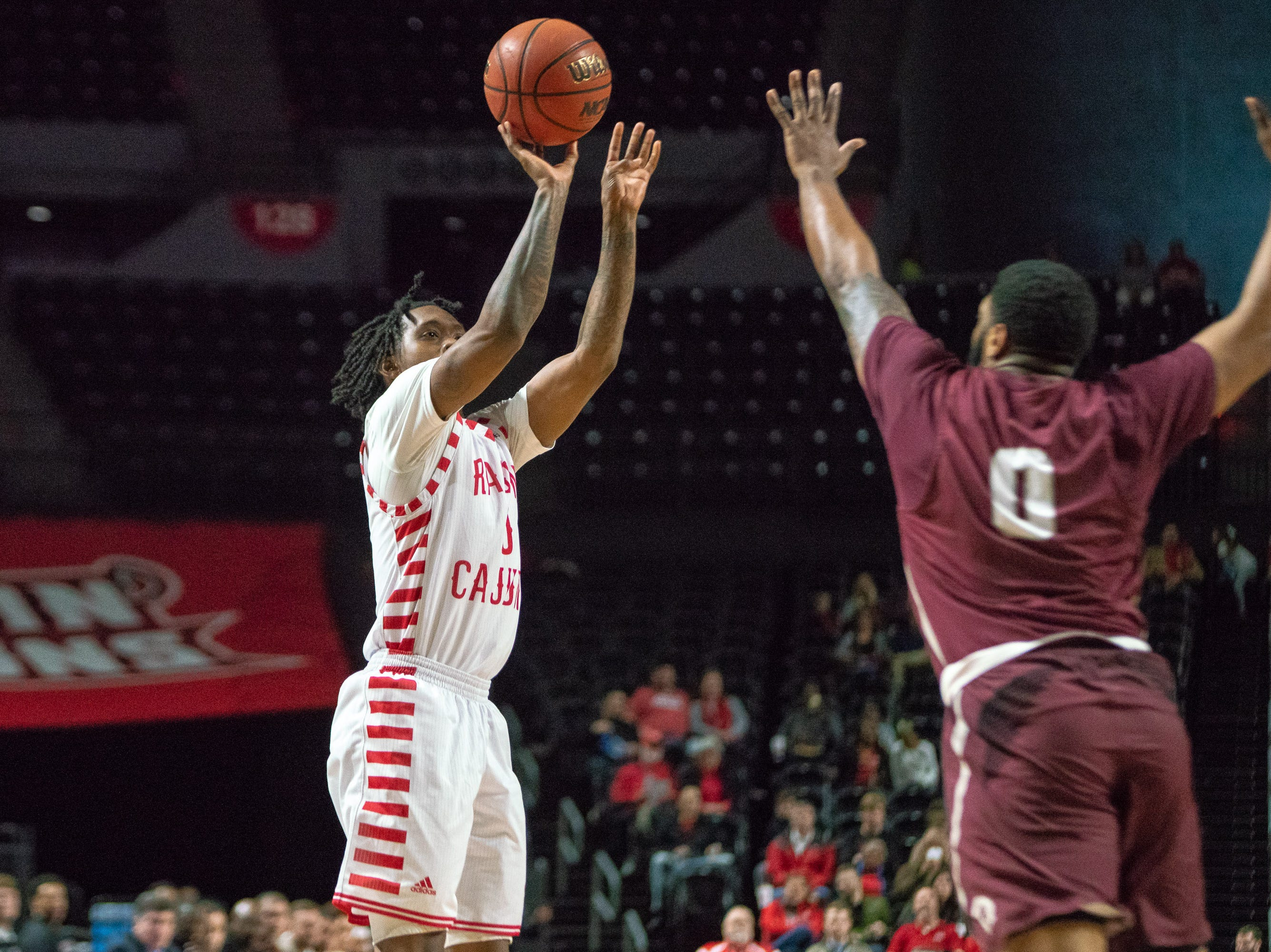 UL's Cedric Russell shoots to score as the Ragin' Cajuns take on the Little Rock Trojans at the Cajundome on January 5, 2019.