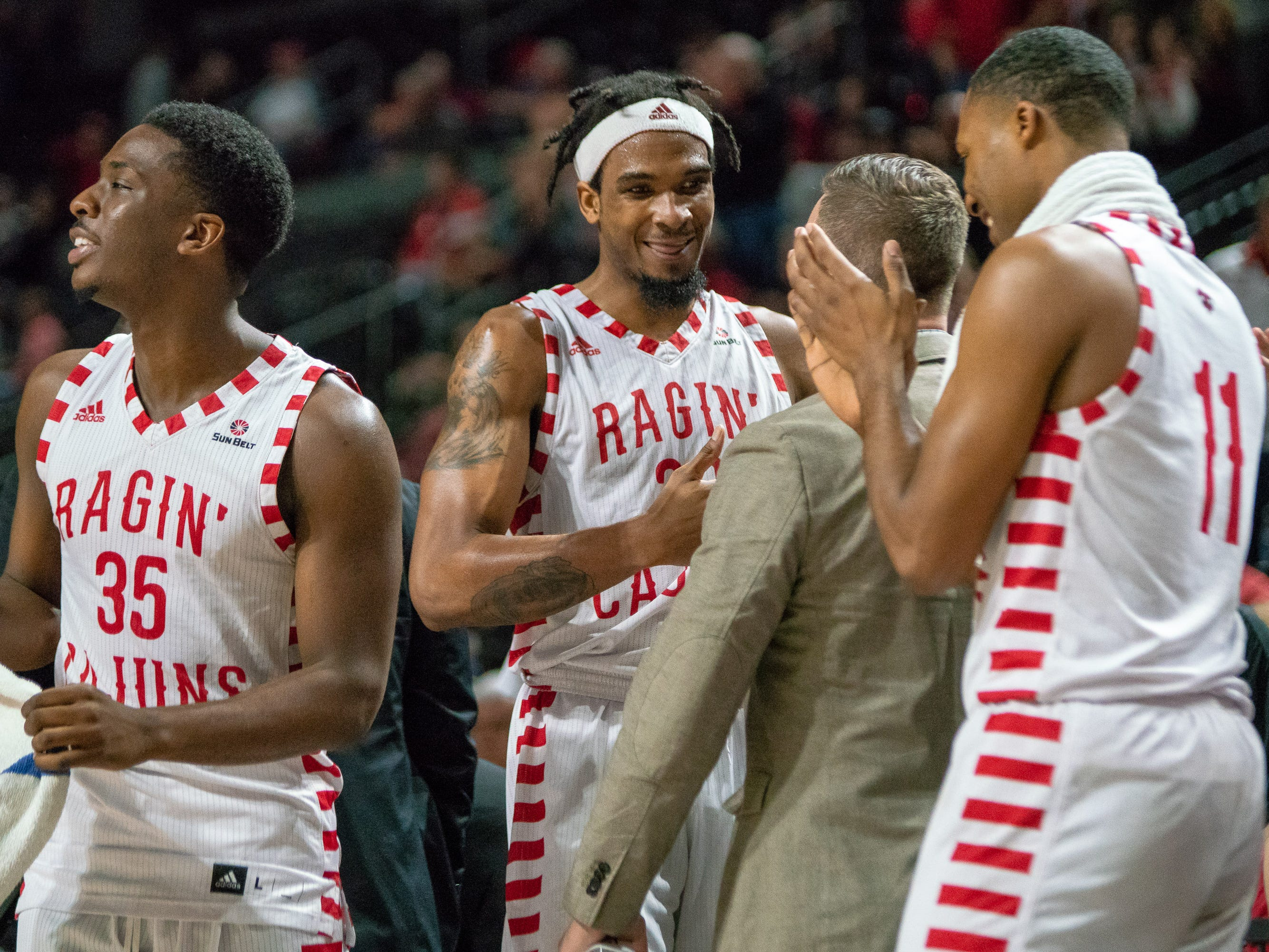 UL's Jakeenan Gant celebrates his 45 point career-high game with his team as the Ragin' Cajuns take on the Little Rock Trojans at the Cajundome on January 5, 2019.