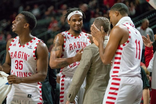 UL's Jakeenan Gant (with headband) celebrates his 45-point game in a Jan. 5 win over Little Rock at the Cajundome.