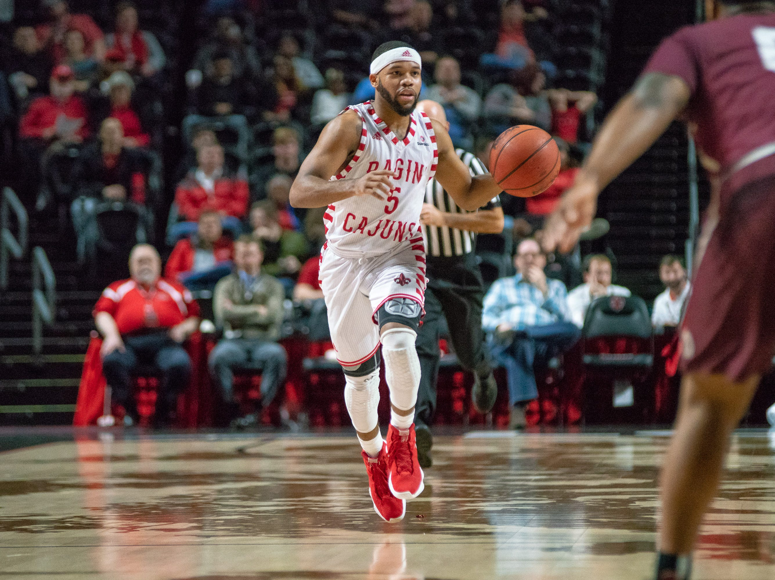 UL's Trajan Wesley moves the ball down the court as the Ragin' Cajuns take on the Little Rock Trojans at the Cajundome on January 5, 2019.