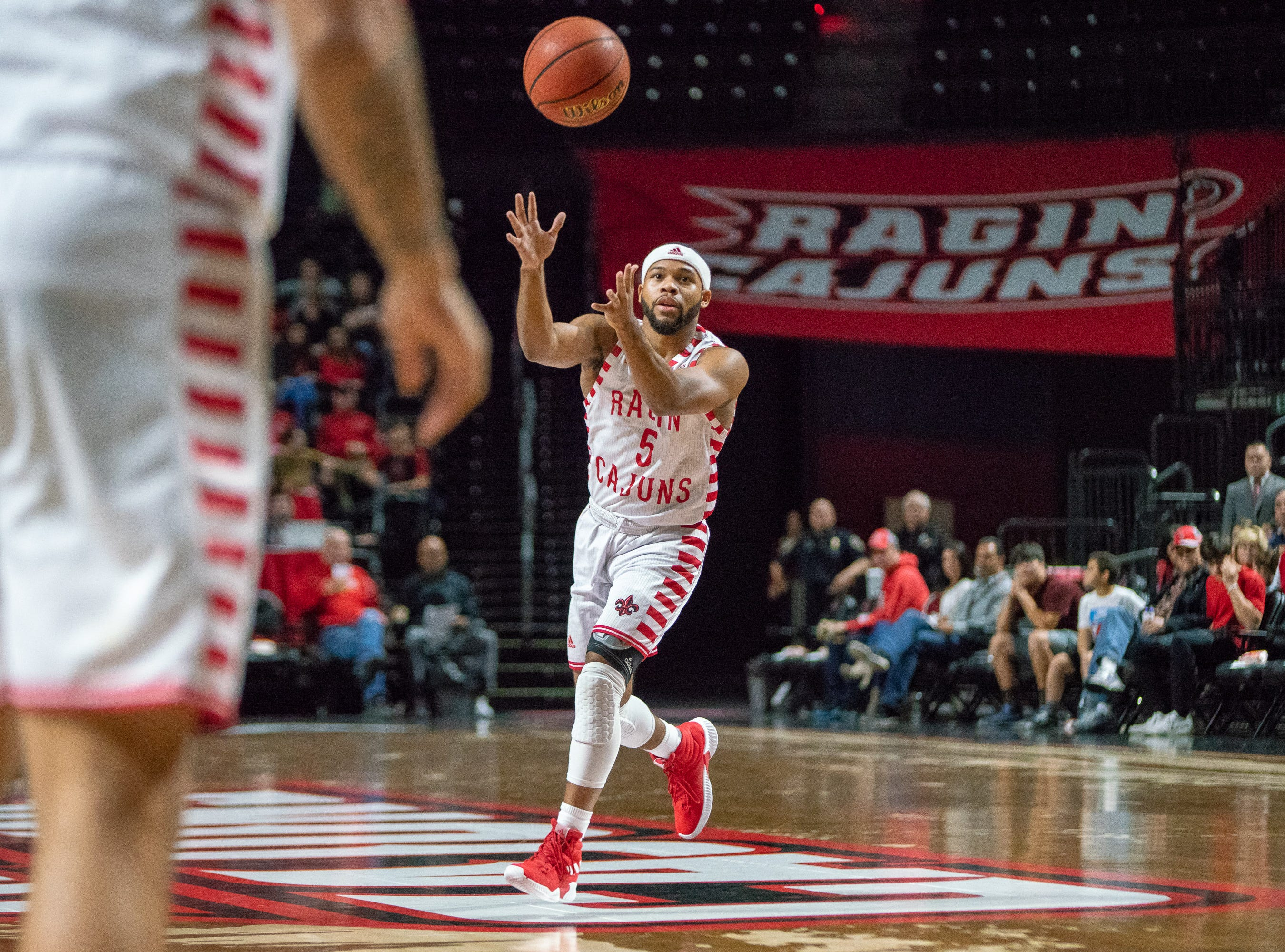 UL's Trajan Wesley catches a pass from a teammate as the Ragin' Cajuns take on the Little Rock Trojans at the Cajundome on January 5, 2019.