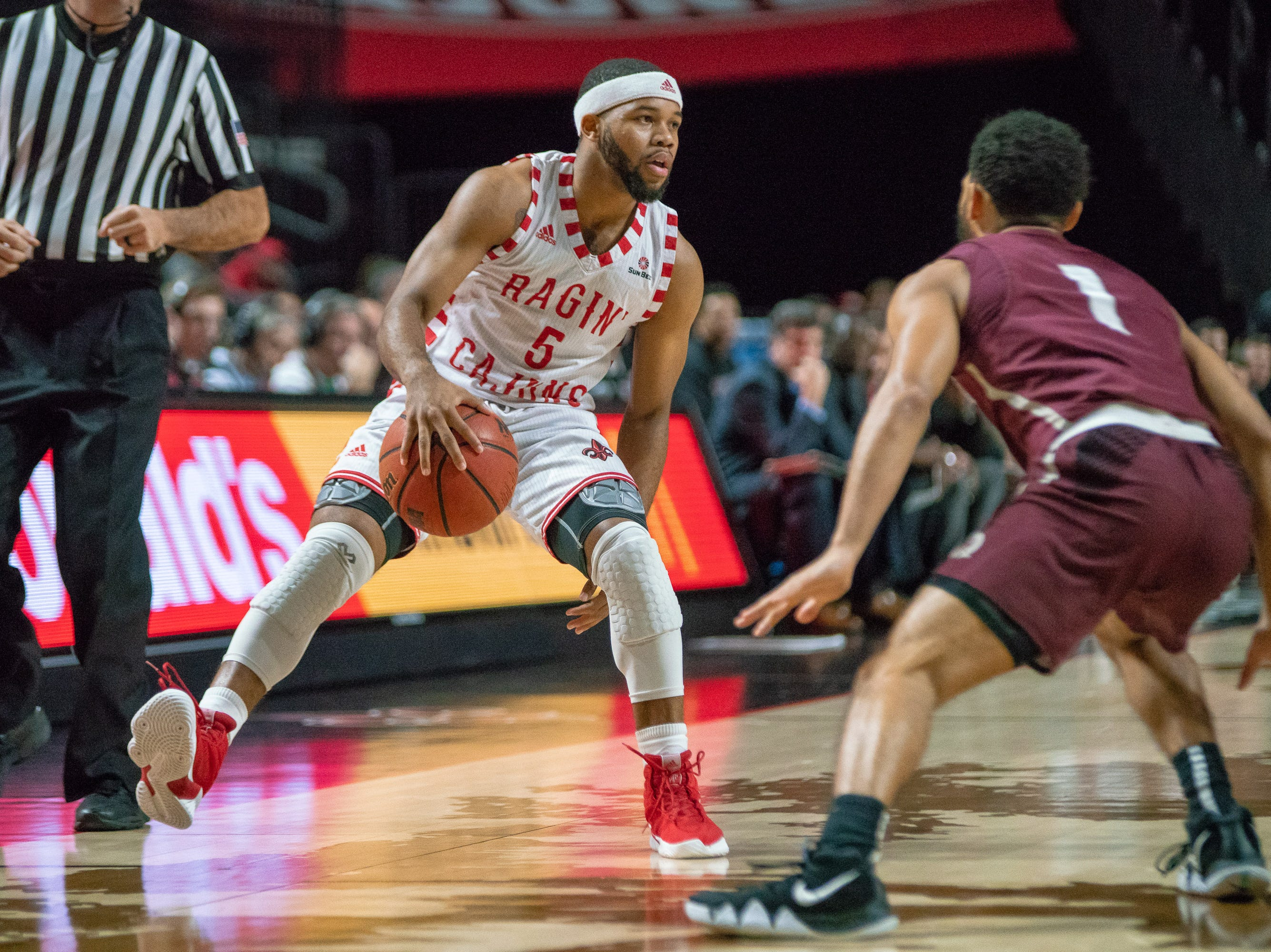 UL's Trajan Wesley handles the ball during the play as the Ragin' Cajuns take on the Little Rock Trojans at the Cajundome on January 5, 2019.