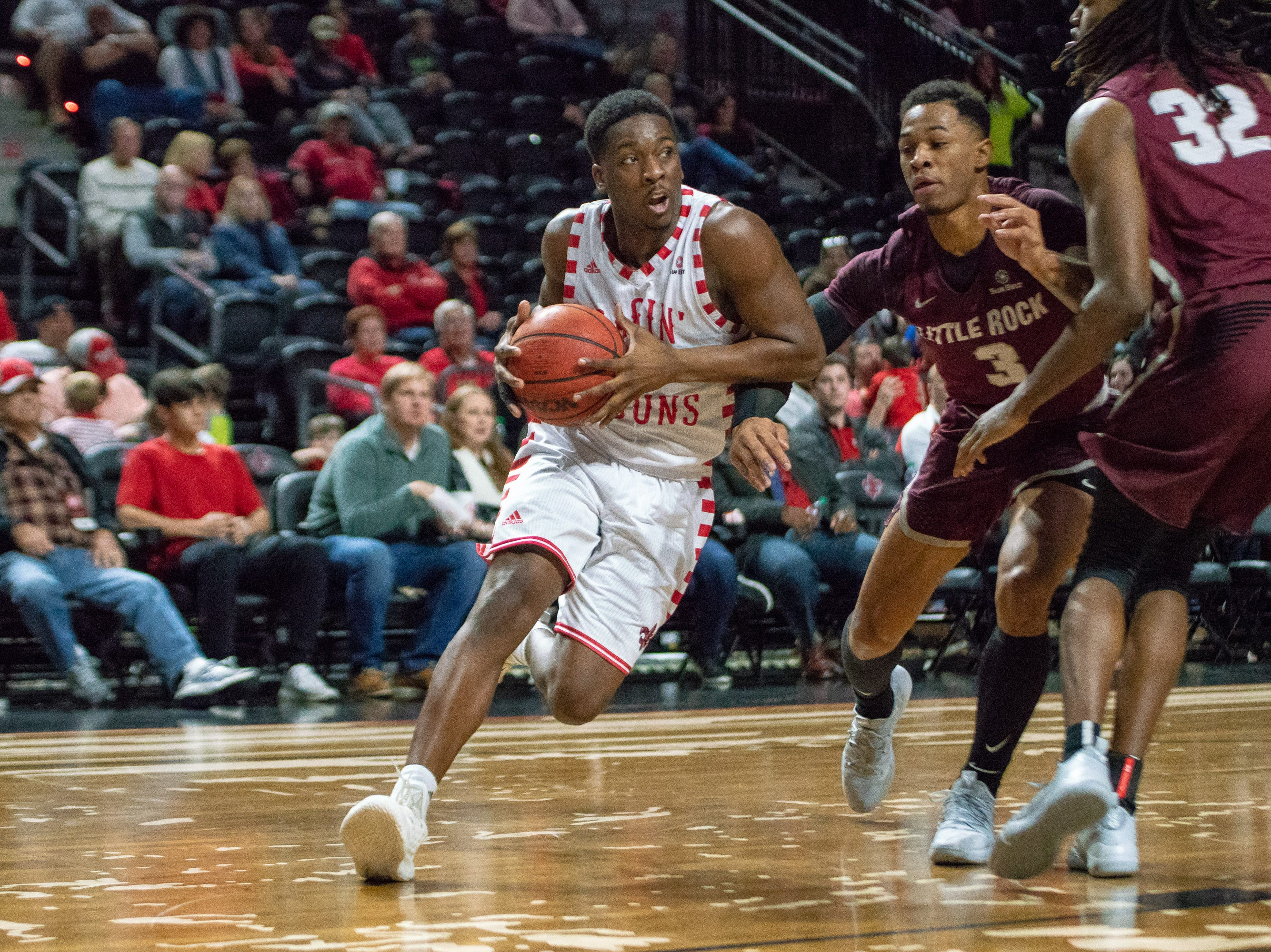 UL's Marcus Stroman drives the ball to the basket as the Ragin' Cajuns take on the Little Rock Trojans at the Cajundome on January 5, 2019.