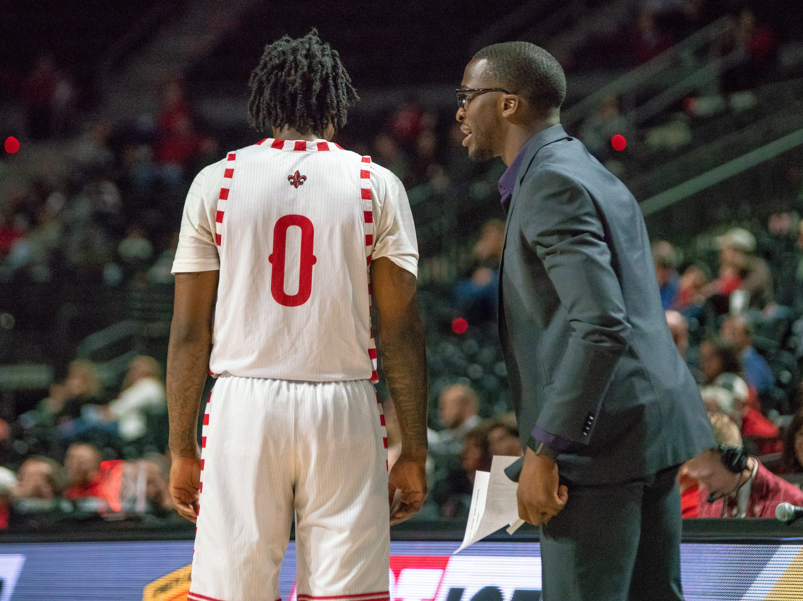 UL's assistant coach Josten Crow talks to Cedric Russell on the sidelines as the Ragin' Cajuns take on the Little Rock Trojans at the Cajundome on January 5, 2019.