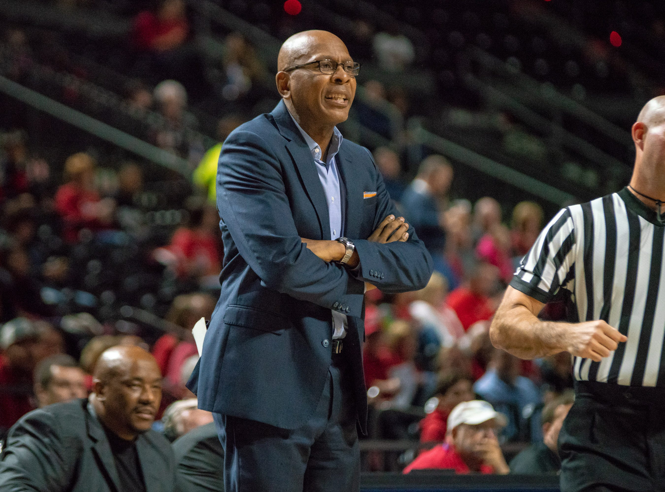 Little Rock's head coach Darrell Walker talks to his players from the sideline as the Ragin' Cajuns take on the Little Rock Trojans at the Cajundome on January 5, 2019.