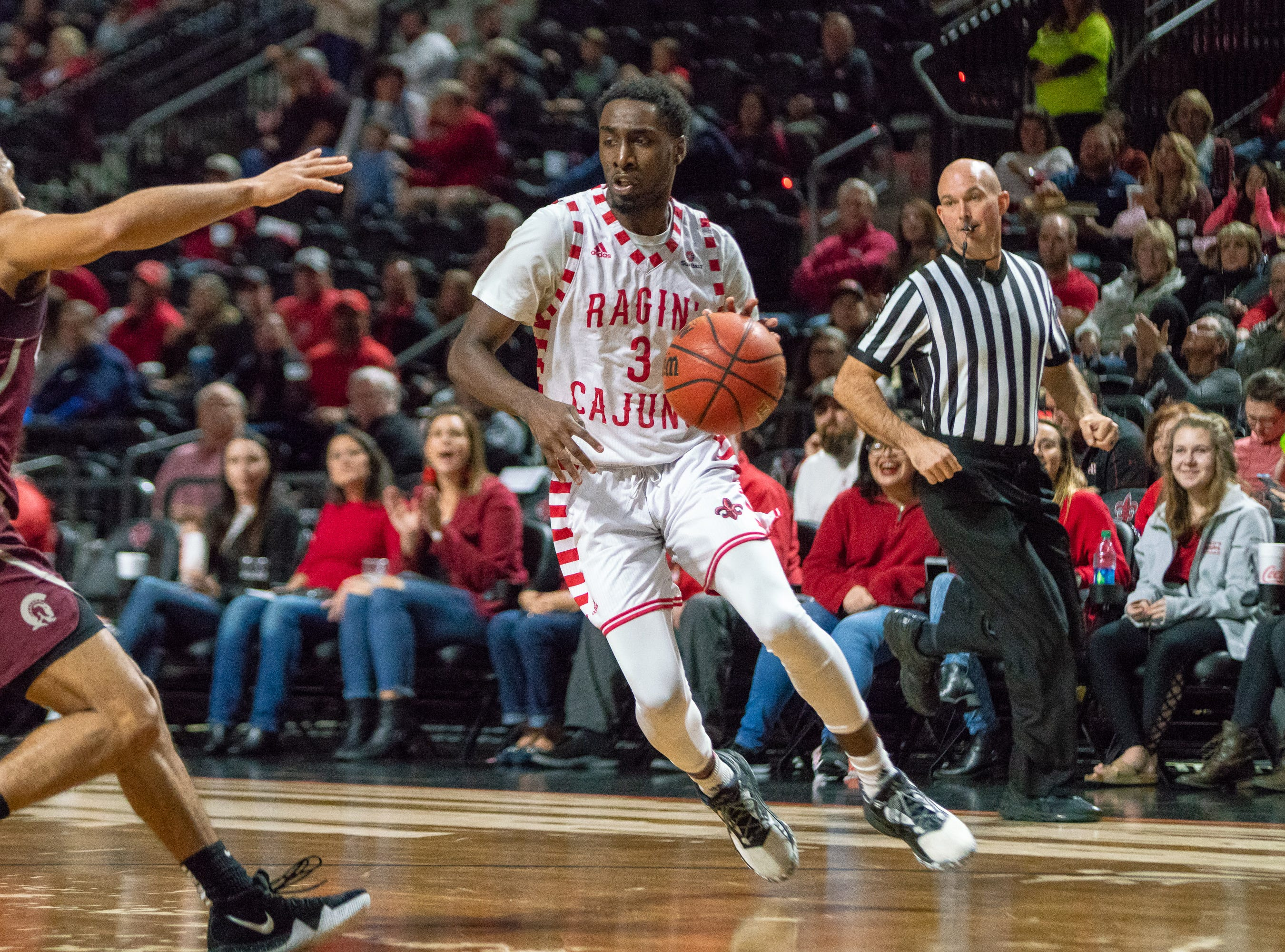 UL's Jeremy Hayes drives to the goal as the Ragin' Cajuns take on the Little Rock Trojans at the Cajundome on January 5, 2019.