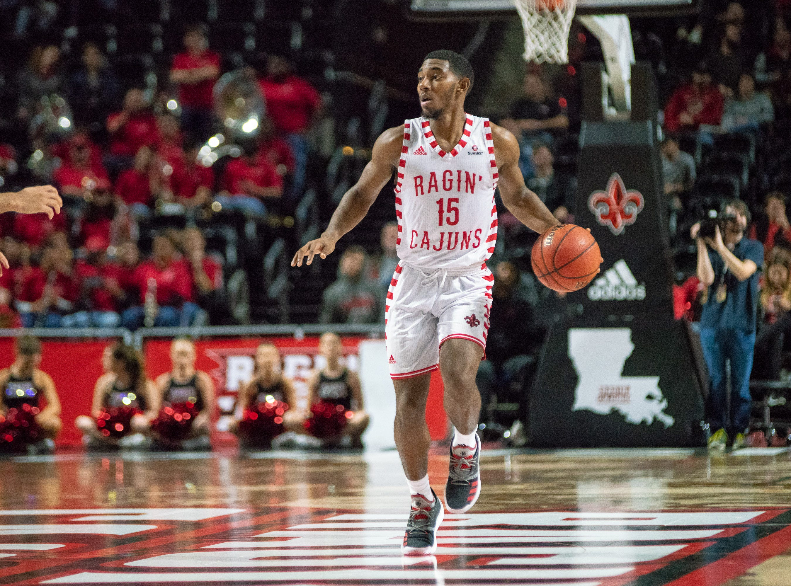 UL's P.J. Hardy moves the ball down the court as the Ragin' Cajuns take on the Little Rock Trojans at the Cajundome on January 5, 2019.