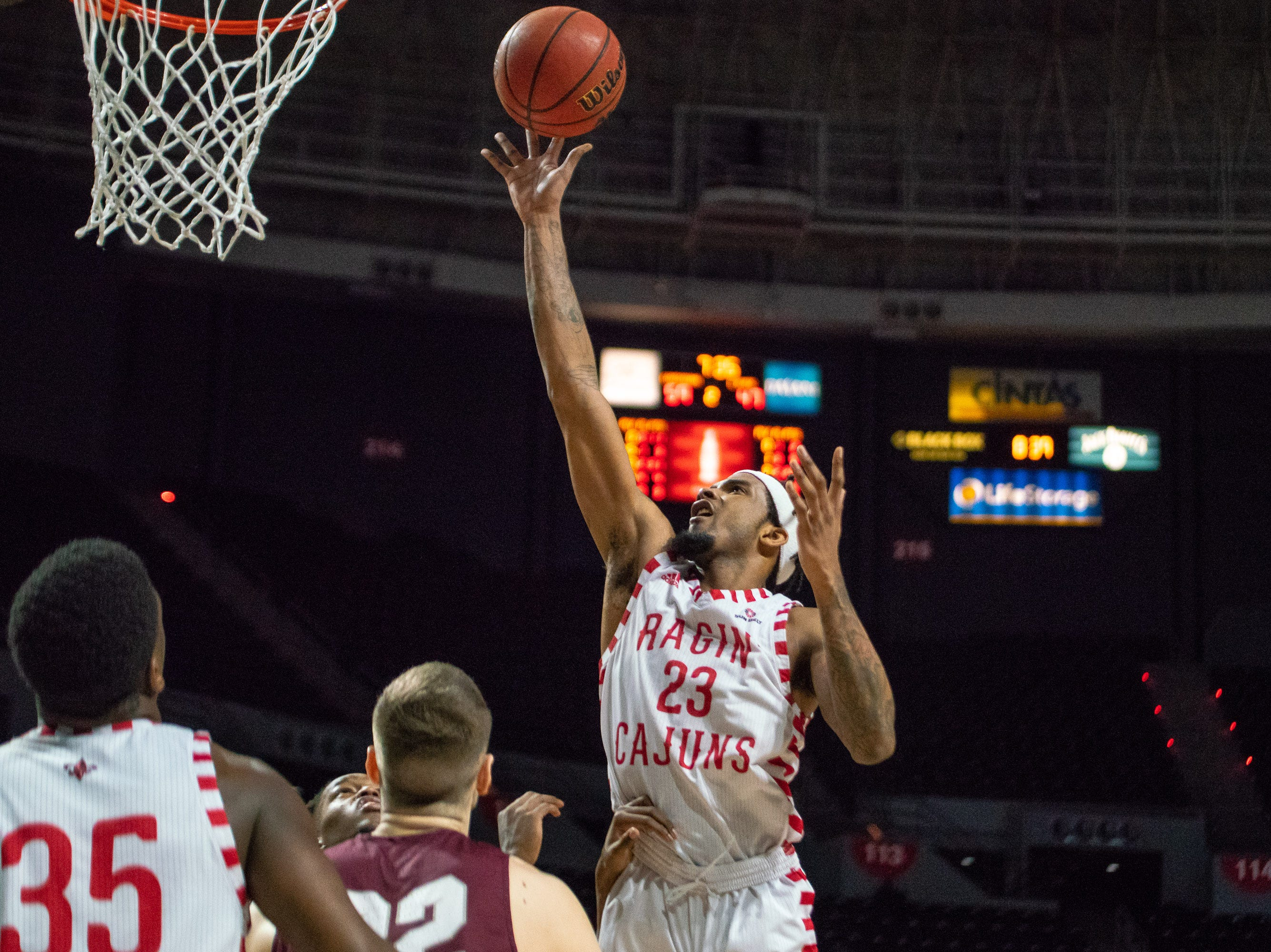 UL's Jakeenan Gant goes up to the goal to score as the Ragin' Cajuns take on the Little Rock Trojans at the Cajundome on January 5, 2019.