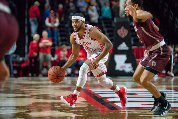 UL's Trajan Wesley moves the ball on the court as the Ragin' Cajuns take on the Little Rock Trojans at the Cajundome on January 5, 2019.