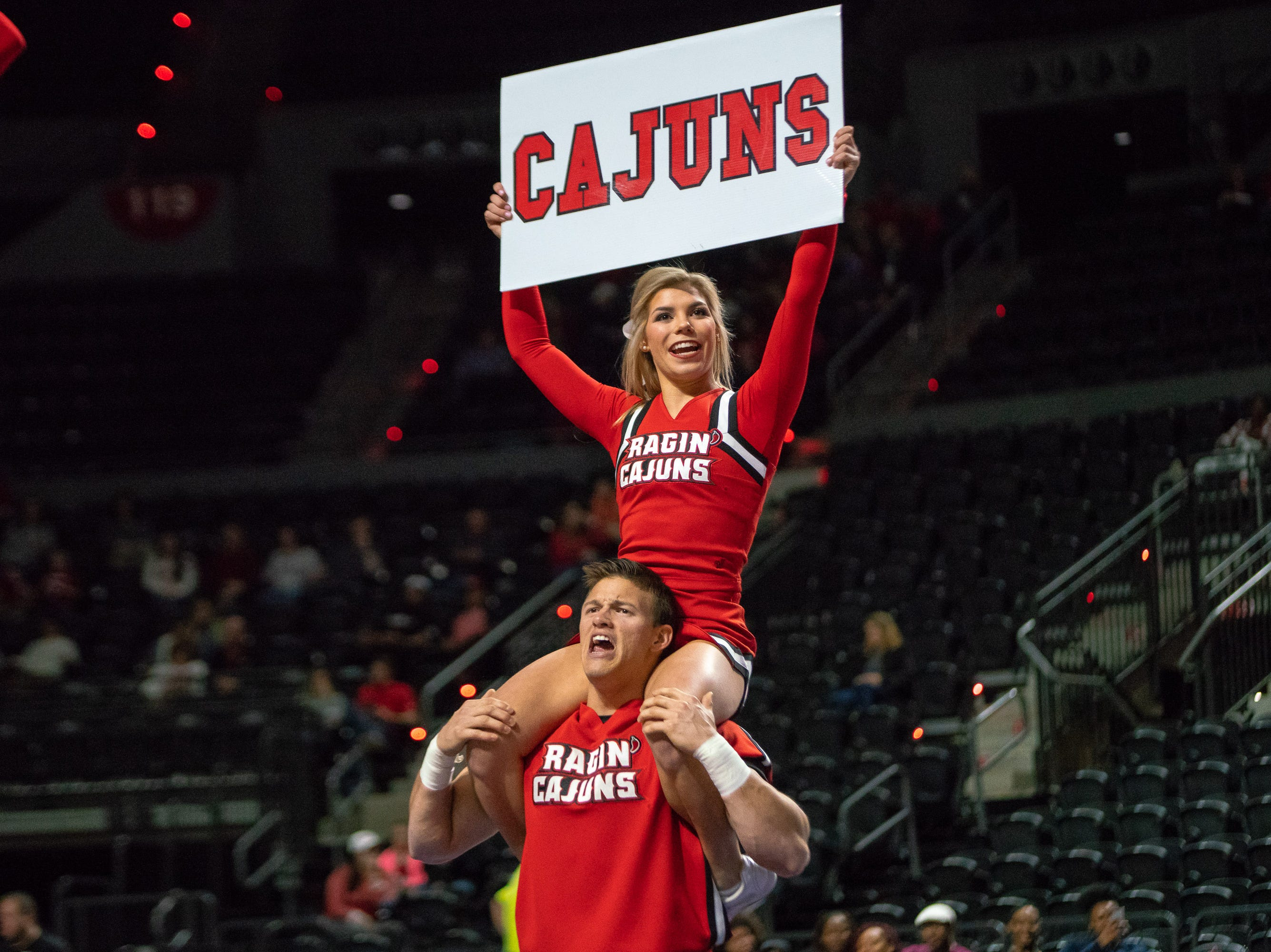 The Ragin' Cajun cheerleaders perform their routine at half-time as the Ragin' Cajuns take on the Little Rock Trojans at the Cajundome on January 5, 2019.
