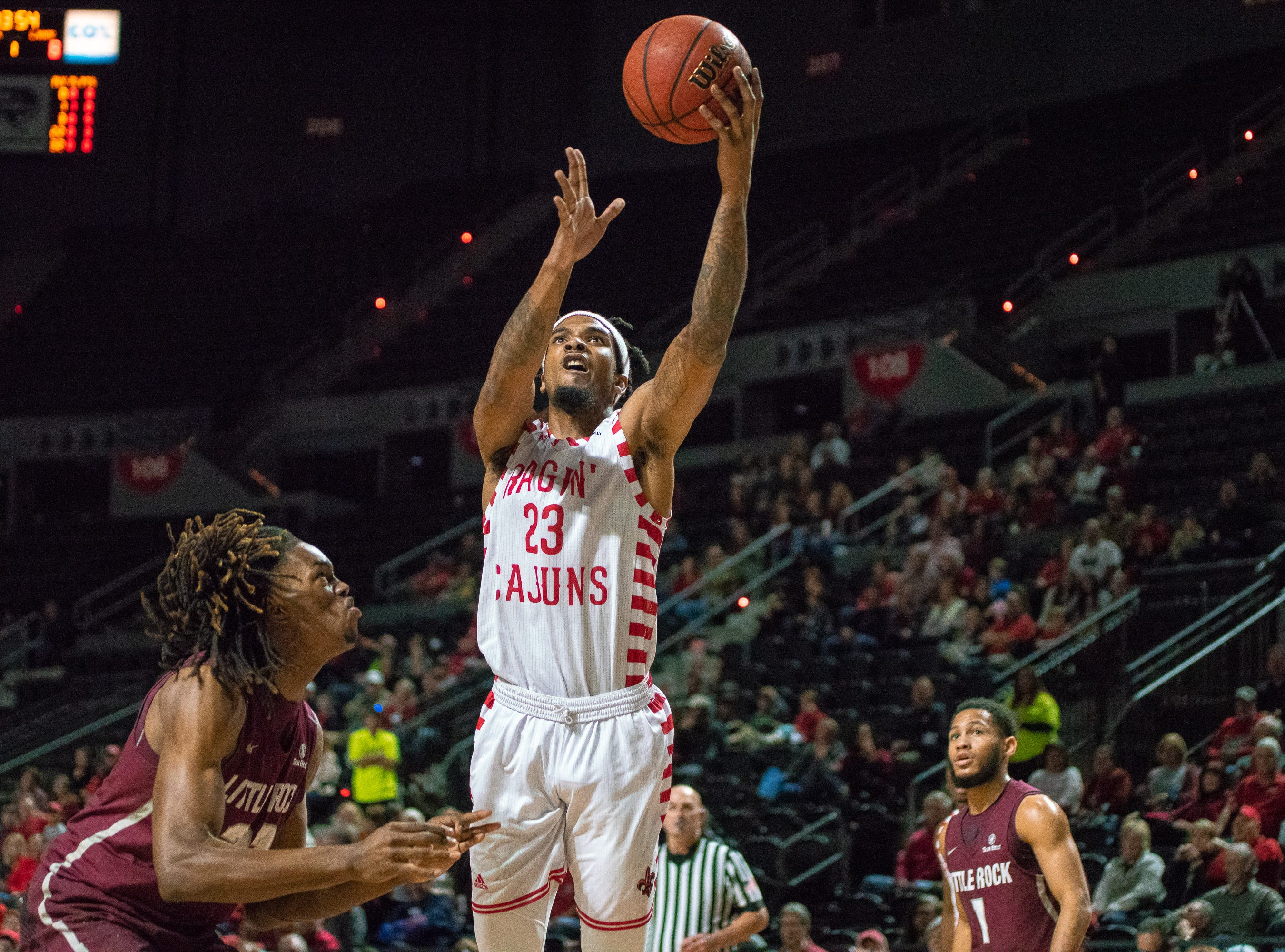 UL's Jakeenan Gant goes up to the goal to score a layup as the Ragin' Cajuns take on the Little Rock Trojans at the Cajundome on January 5, 2019.