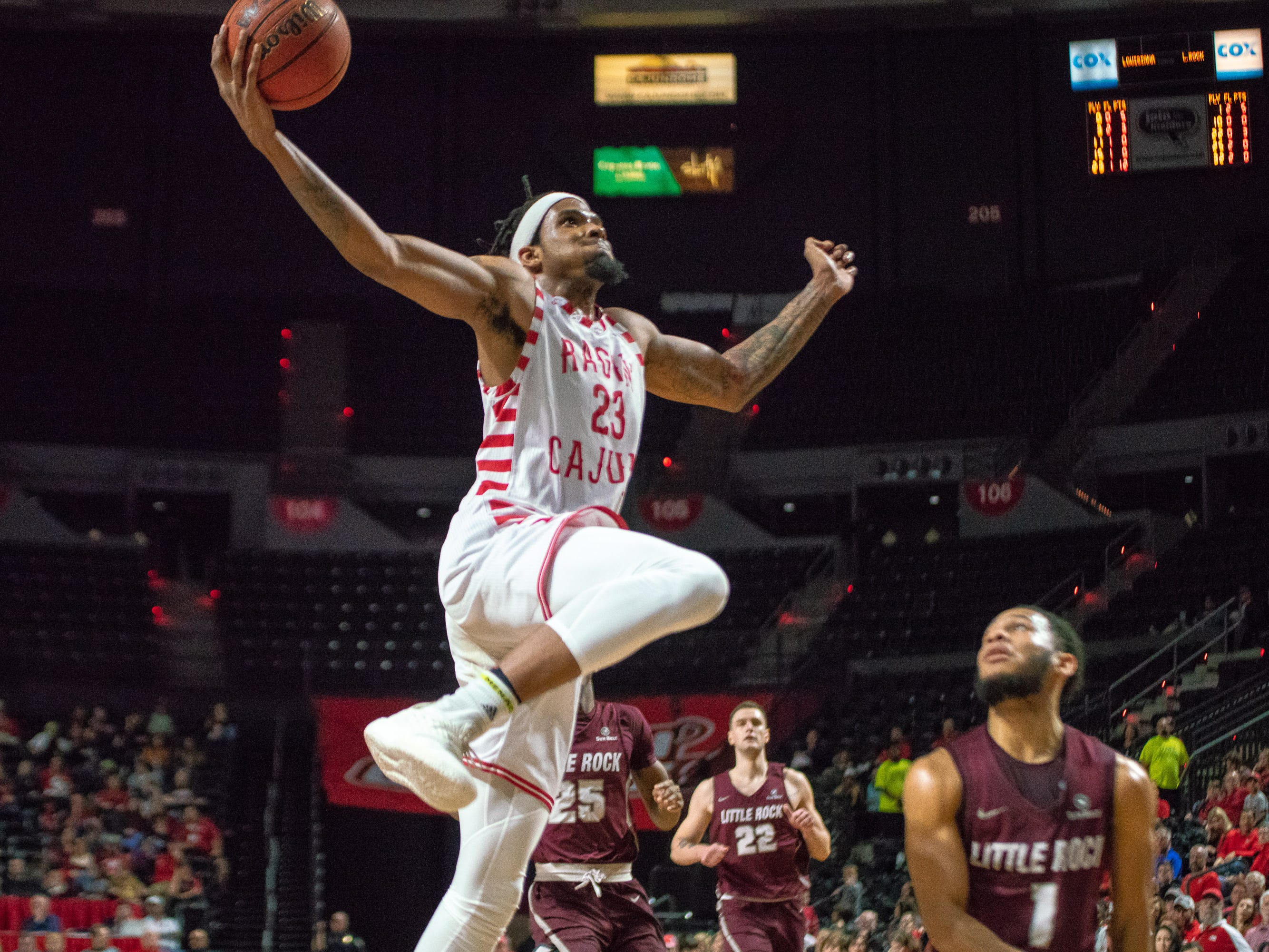 UL's Jakeenan Gant leaps high to score a layup as the Ragin' Cajuns take on the Little Rock Trojans at the Cajundome on January 5, 2019.