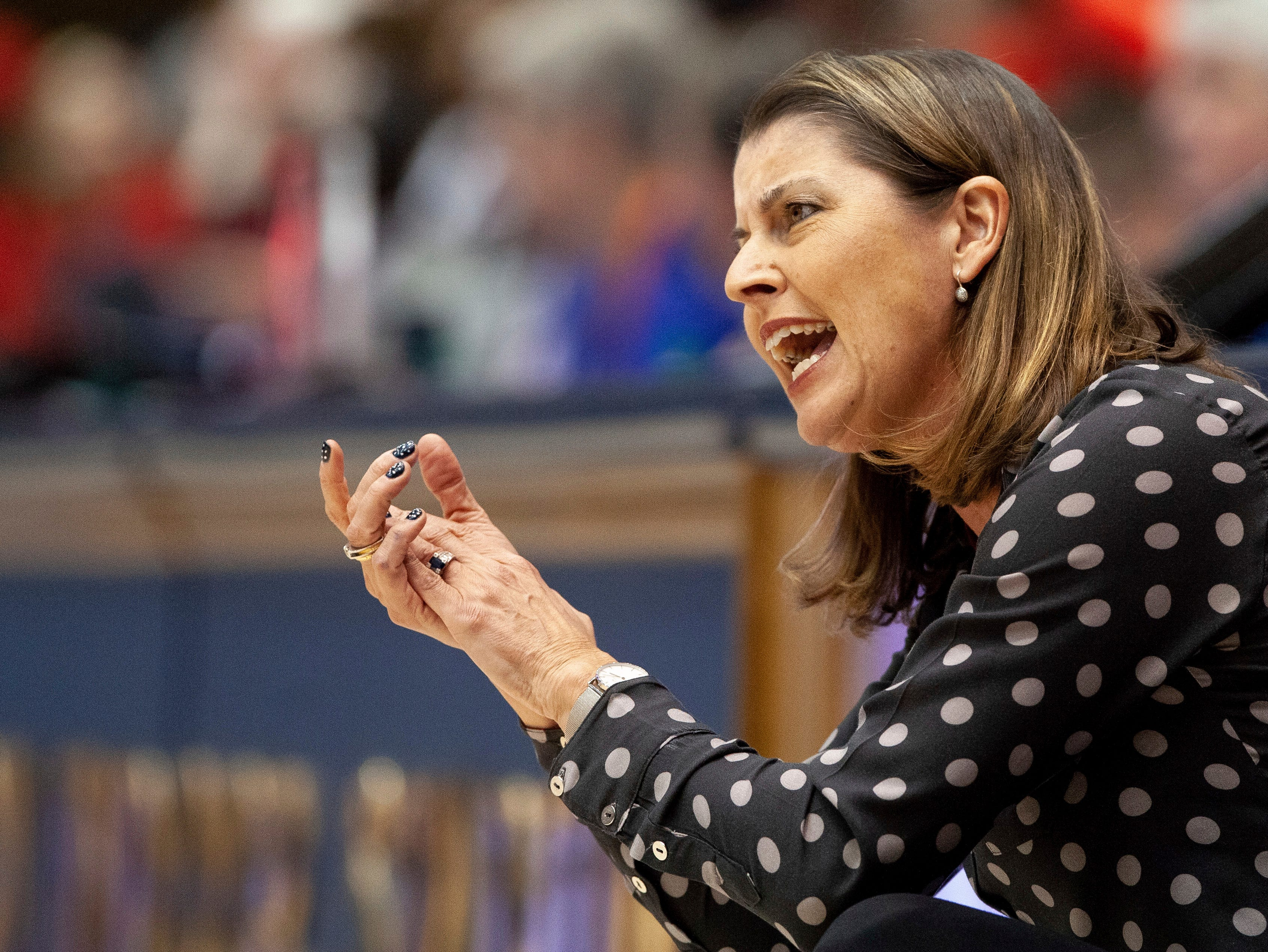 Duke head coach Joanne McCallie encourages her team during the first half of an NCAA college basketball game against Louisville in Durham, N.C., Sunday, Jan. 6, 2019.