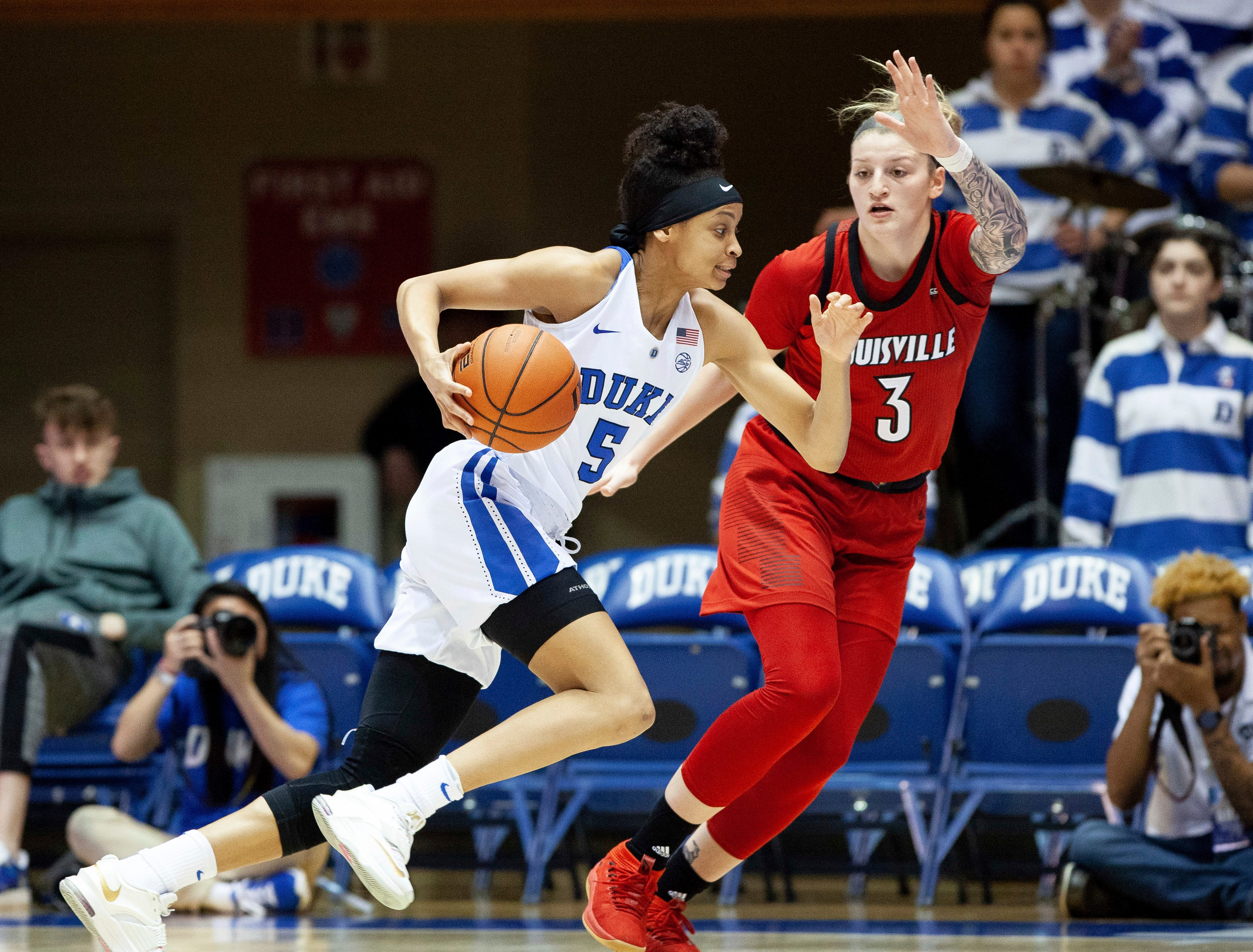 Duke's Leaonna Odom (5) drives against Louisville's Sam Fuehring (3) during the first half of an NCAA college basketball game in Durham, N.C., Sunday, Jan. 6, 2019.