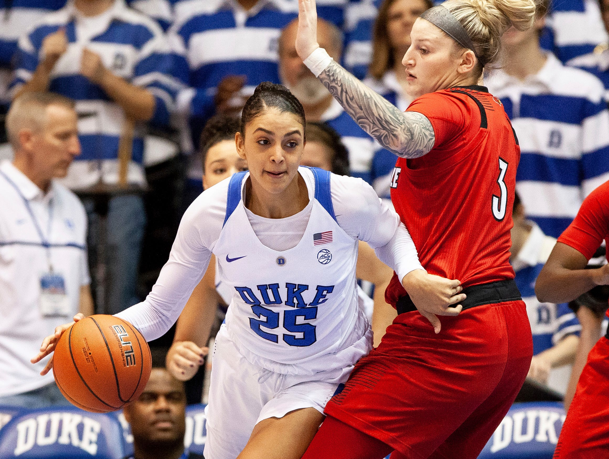 Duke's Jade Williams (25) works in the post against Louisville's Sam Fuehring (3) during the first half of an NCAA college basketball game in Durham, N.C., Sunday, Jan. 6, 2019.