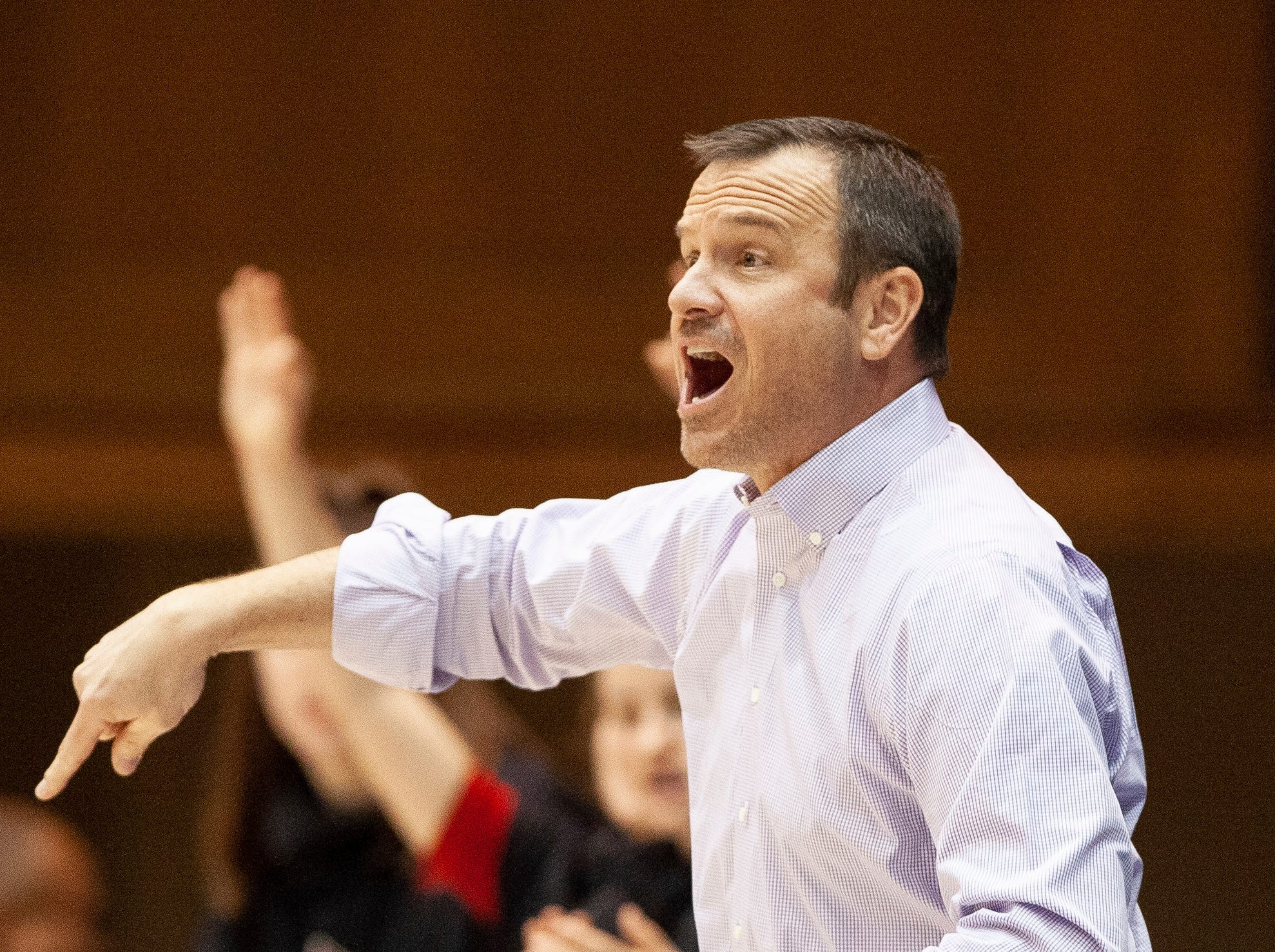 Louisville head coach Jeff Walz directs his team during the first half of an NCAA college basketball game against Duke in Durham, N.C., Sunday, Jan. 6, 2019.