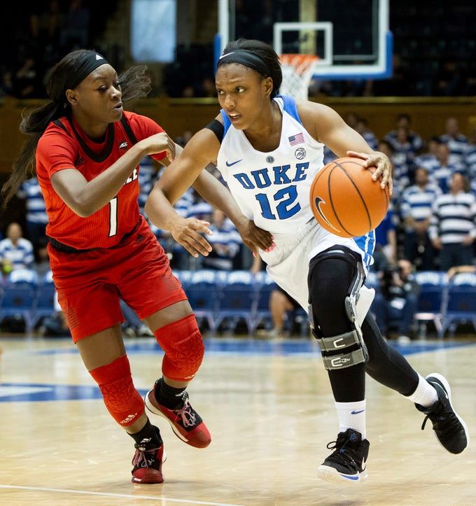 Duke's Mikayla Boykin (12) drives against Louisville's Dana Evans (1) during the second half of an NCAA college basketball game in Durham, N.C., Sunday, Jan. 6, 2019.