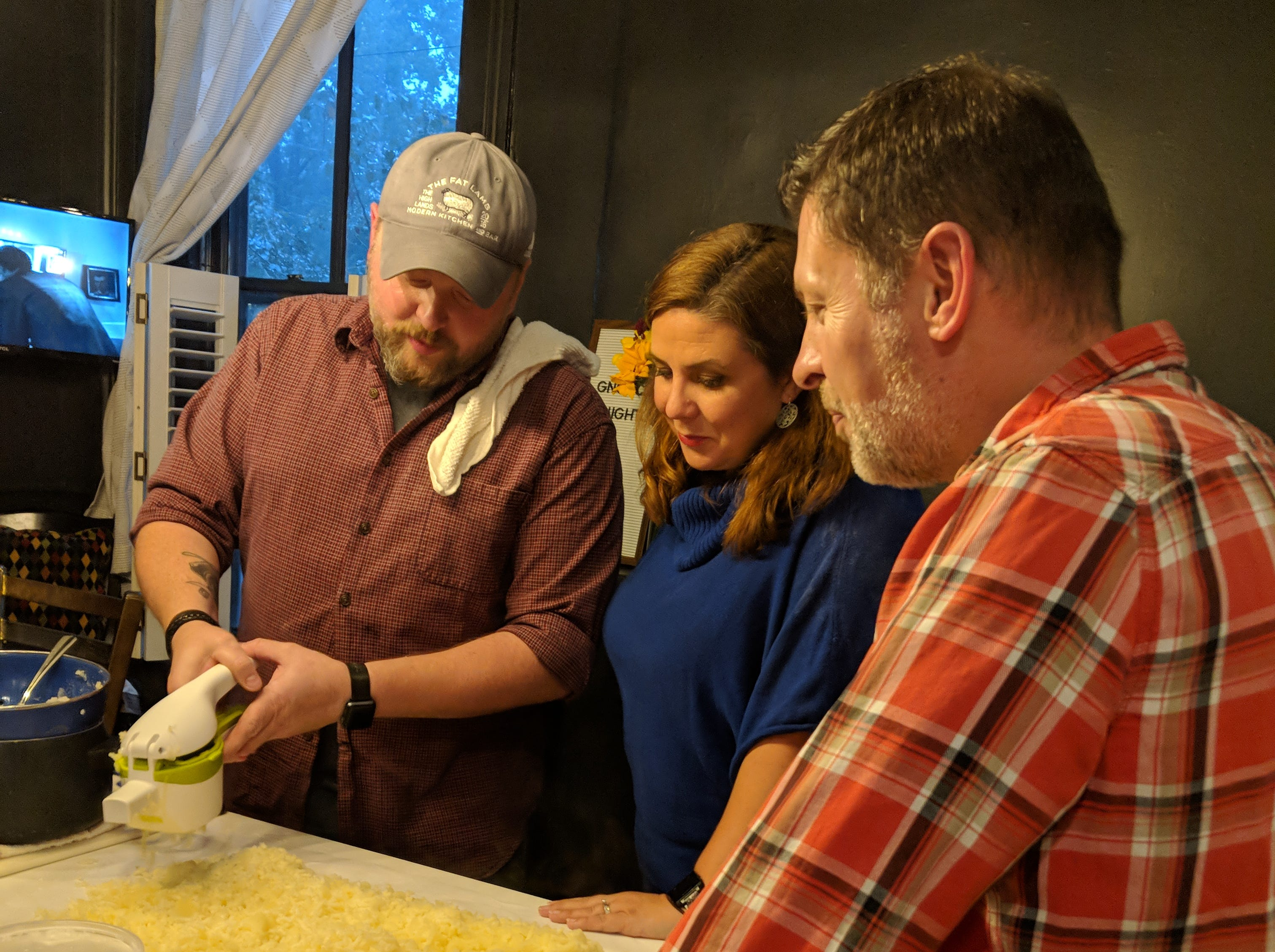 Chef Dallas McGarity, left, shows his wife, Laura, and Dana McMahan's husband Brian how to make his famous gnocchi.