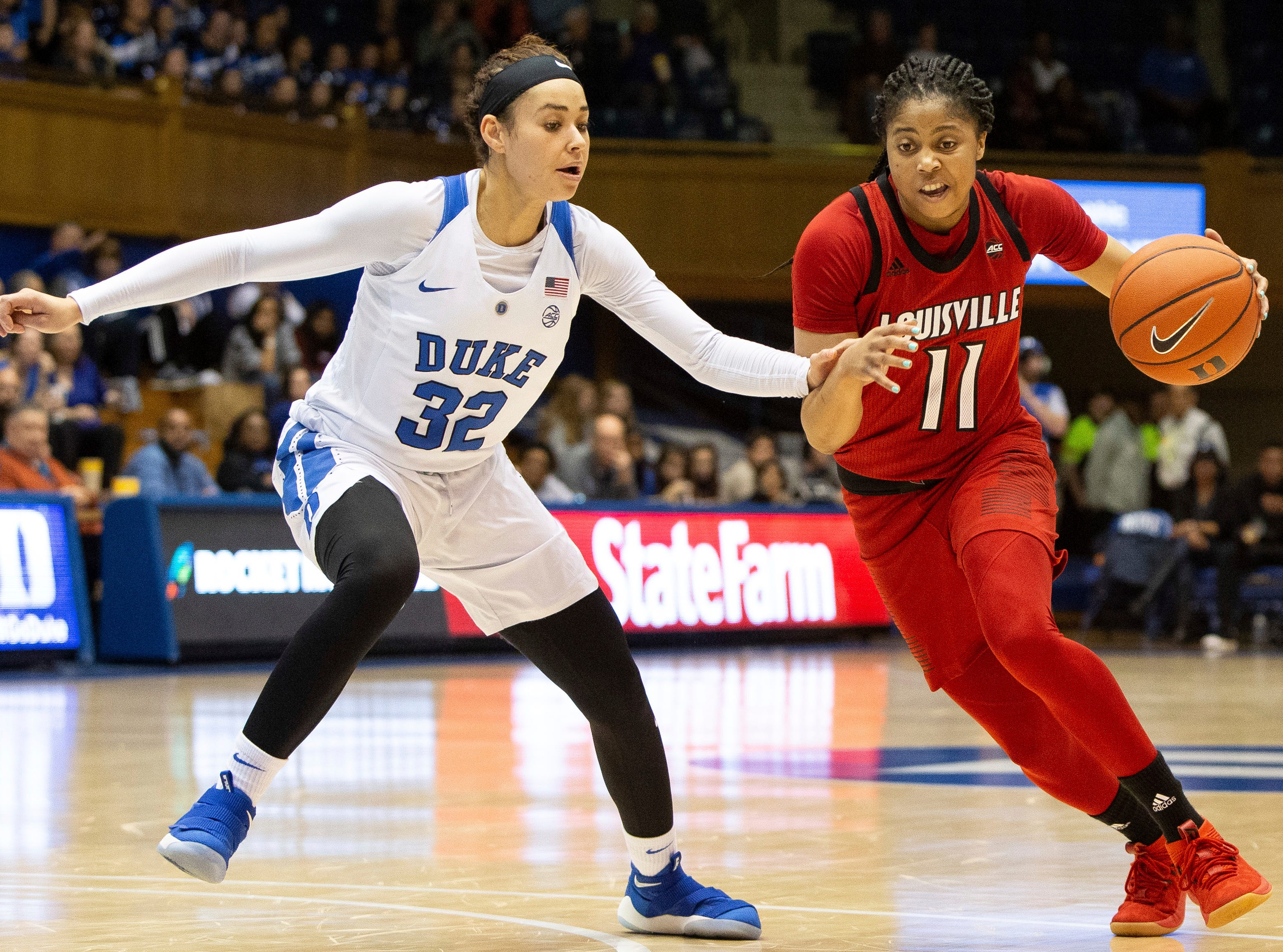 Louisville's Arica Carter (11) drives against Duke's Jayda Adams (32) during the first half of an NCAA college basketball game in Durham, N.C., Sunday, Jan. 6, 2019.