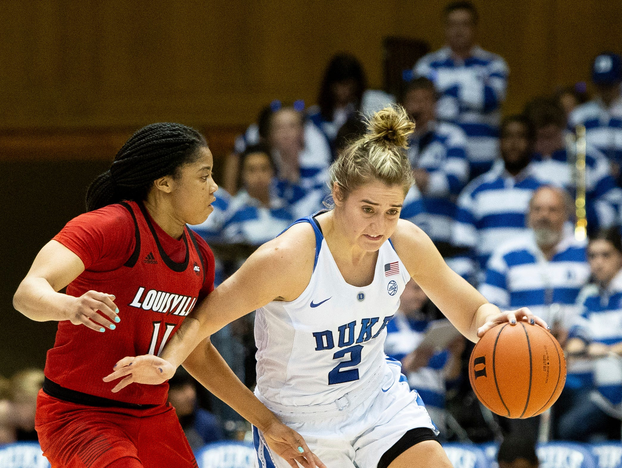 Duke's Haley Gorecki (2) handles the ball as Louisville's Arica Carter (11) defends during the second half of an NCAA college basketball game in Durham, N.C., Sunday, Jan. 6, 2019.