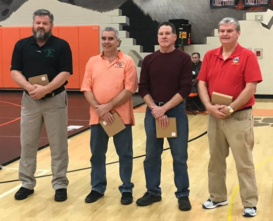 Special recognition was given to, left to right, Tom Stortz, Mike Lehman, Bill Kempton and Pat Pearl for their contributions to wrestling prior to Saturday's championship round in the 57th J.C. Gorman Invitational.
