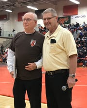 Chuck Riley received the Halley Weaver Volunteer Award from Halley Weaver (right) for his service to the J.c. Gorman Invitational