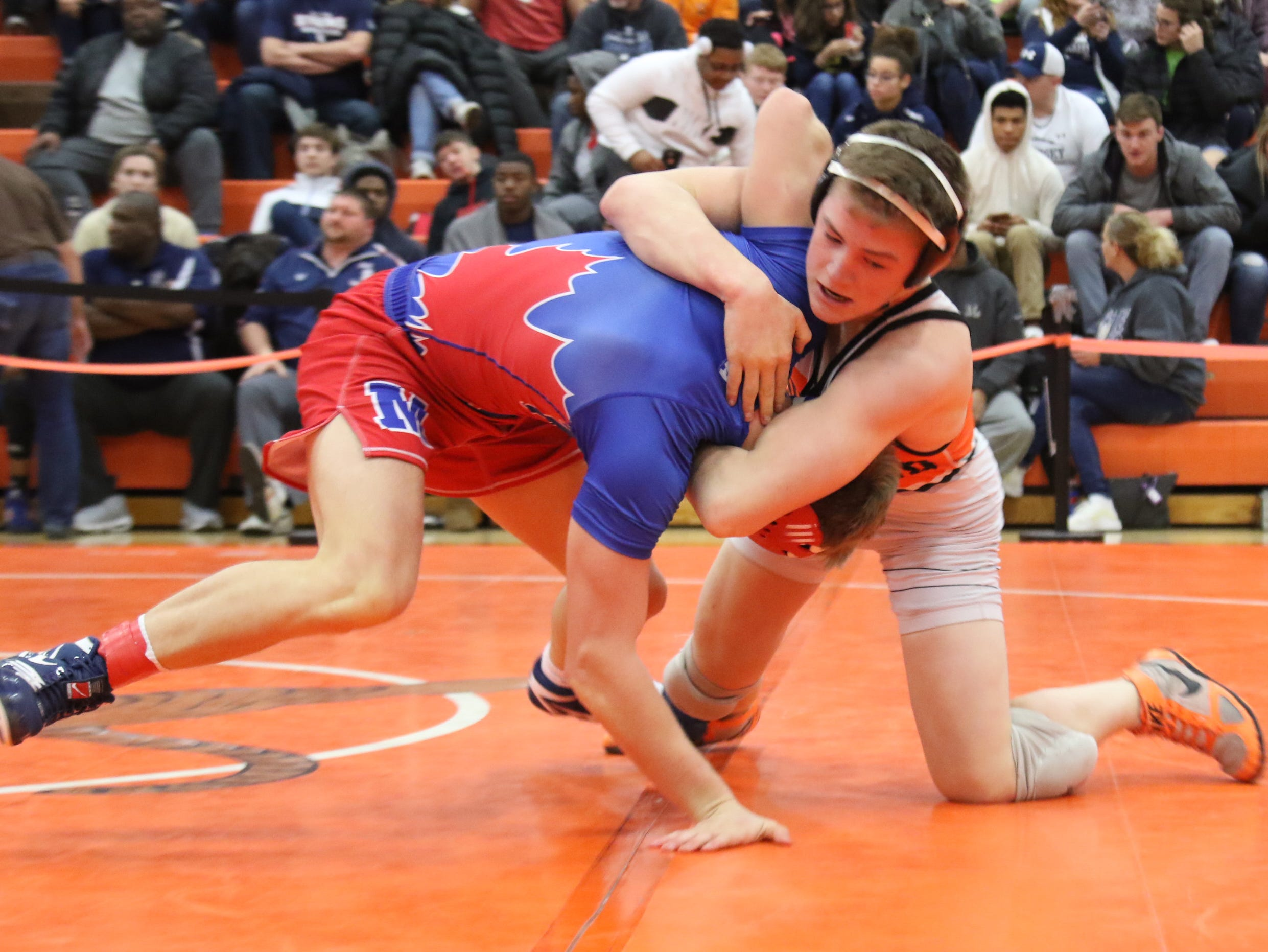Ashland's Austin McNamara spars with Mapleton's Beau Lefever during the final matches at the JC Gorman Wrestling Tournament on Saturday.