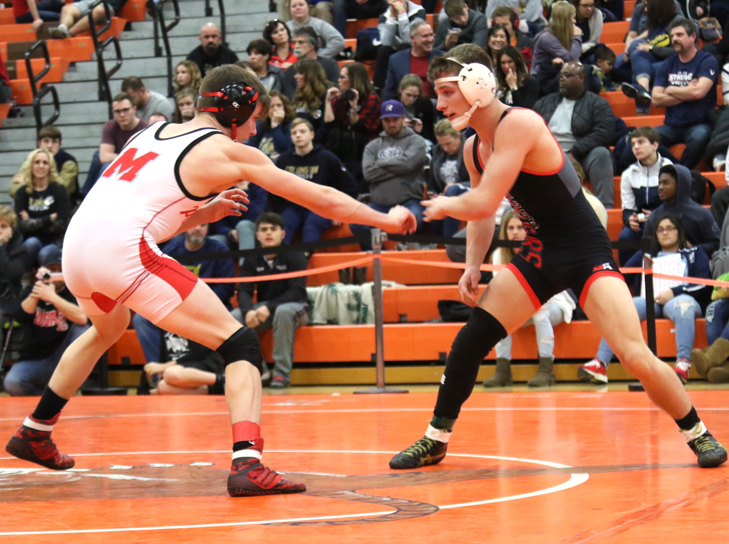 Crestview's Dakota BLanton spars with Akron Manchester's Jake White during the final matches at the JC Gorman Wrestling Tournament on Saturday.