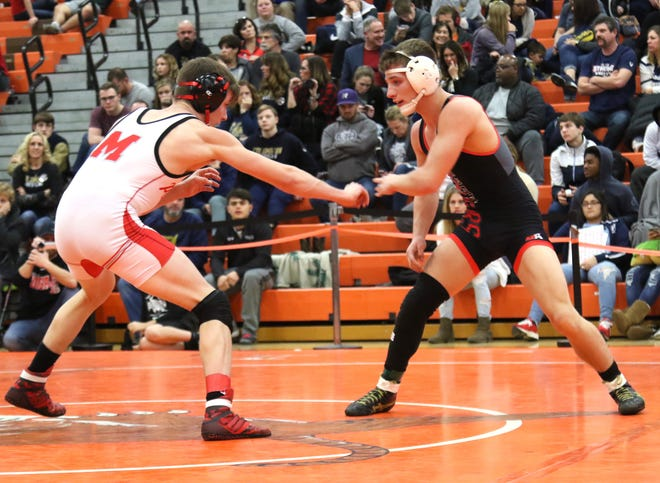Crestview's three-time state qualifier Dakota Blanton (right) lived up to his No. 4 state ranking by beating eighth-ranked and two-time state qualifier Jake White of Akron Manchester 4-1 in the 132-pound finals of the 57th J.C. Gorman Invitational.