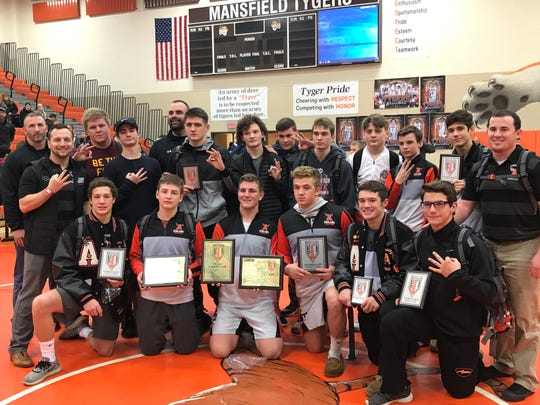 Sean Seder's Ashland Arrows won their third straight J.C. Gorman Invitational title behind individual champs Austin McNamara and Josh Bever (second and third from left, front row).