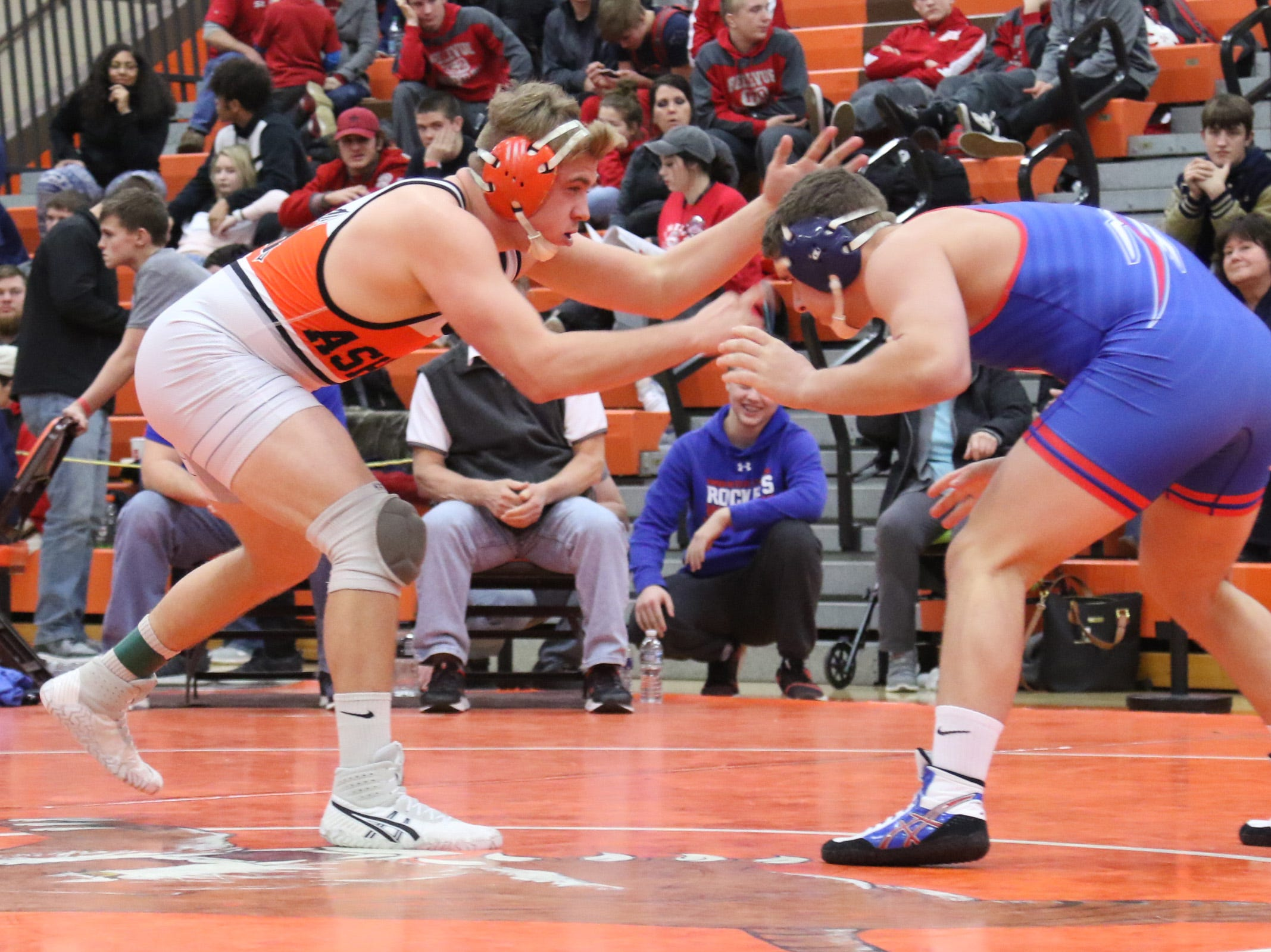Ashland's Tristian Pitz spars with Bay's Matt Cover during the final matches at the JC Gorman Wrestling Tournament on Saturday.