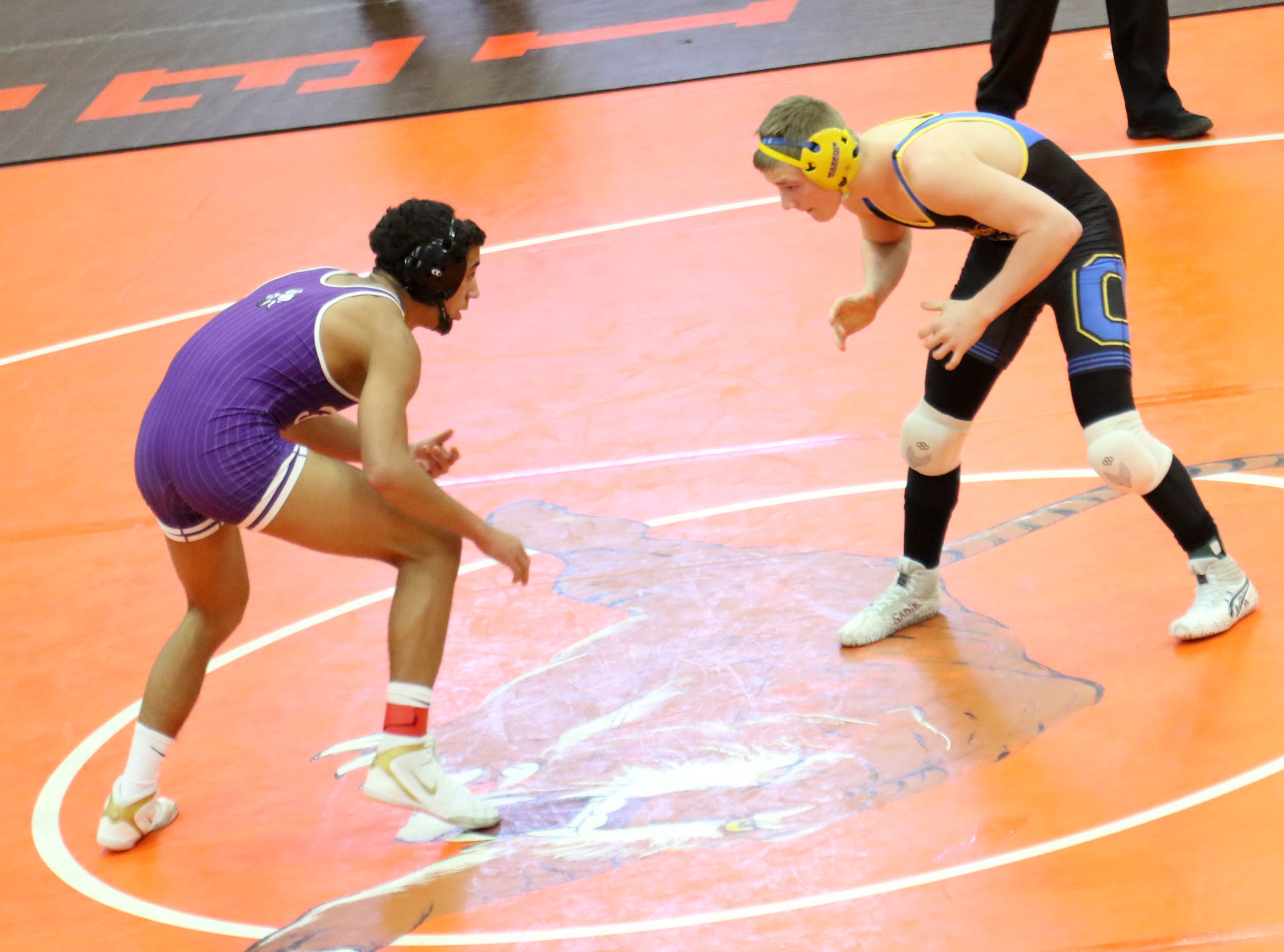 Ontario's Ethan Tumbaugh spars with Fremont Ross' Deshea Pettiford during the final matches at the JC Gorman Wrestling Tournament on Saturday.