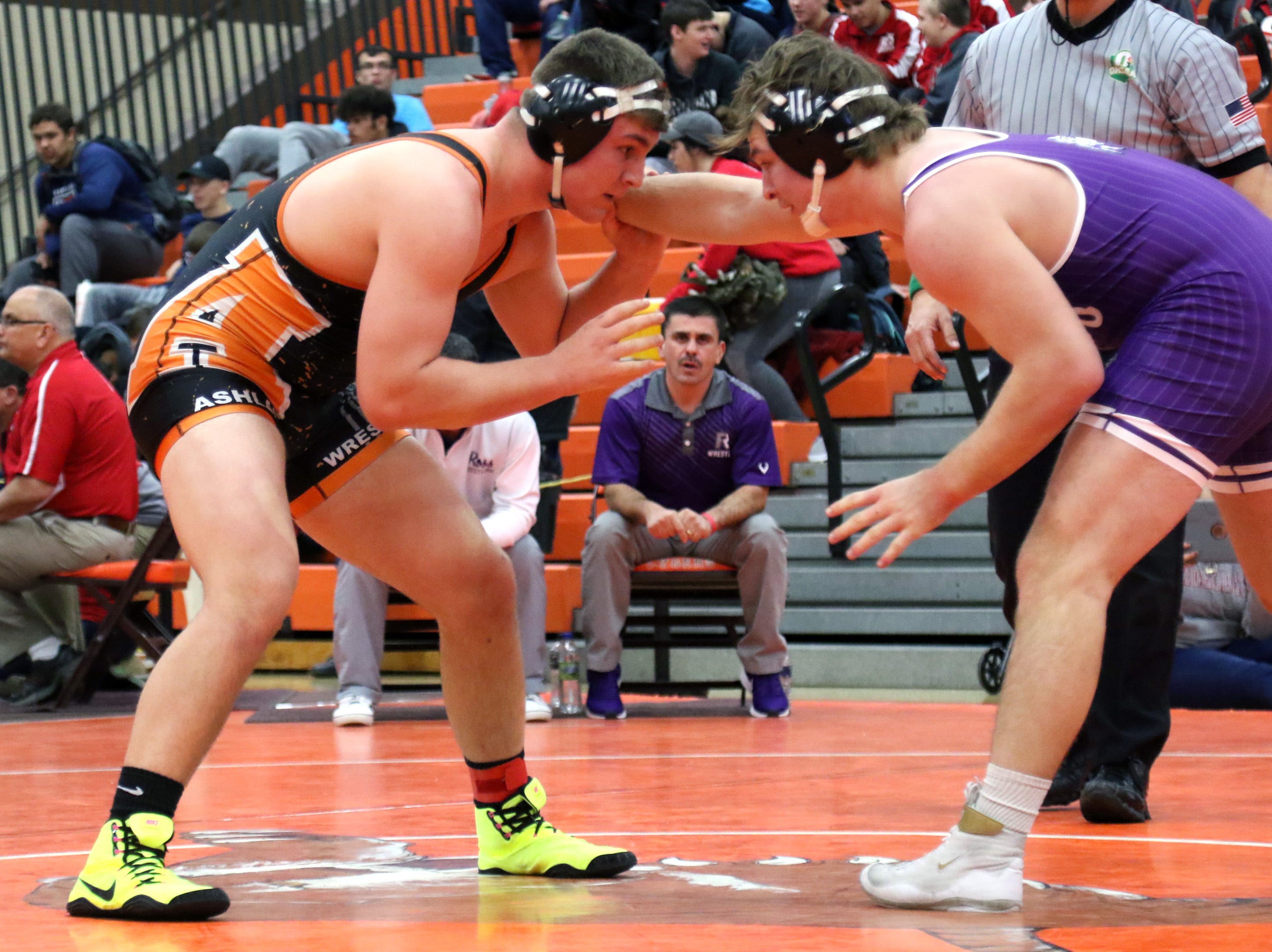 Ashland's Josh Bever spars with Fremont Ross' Caleb Wood during the final matches at the JC Gorman Wrestling Tournament on Saturday.
