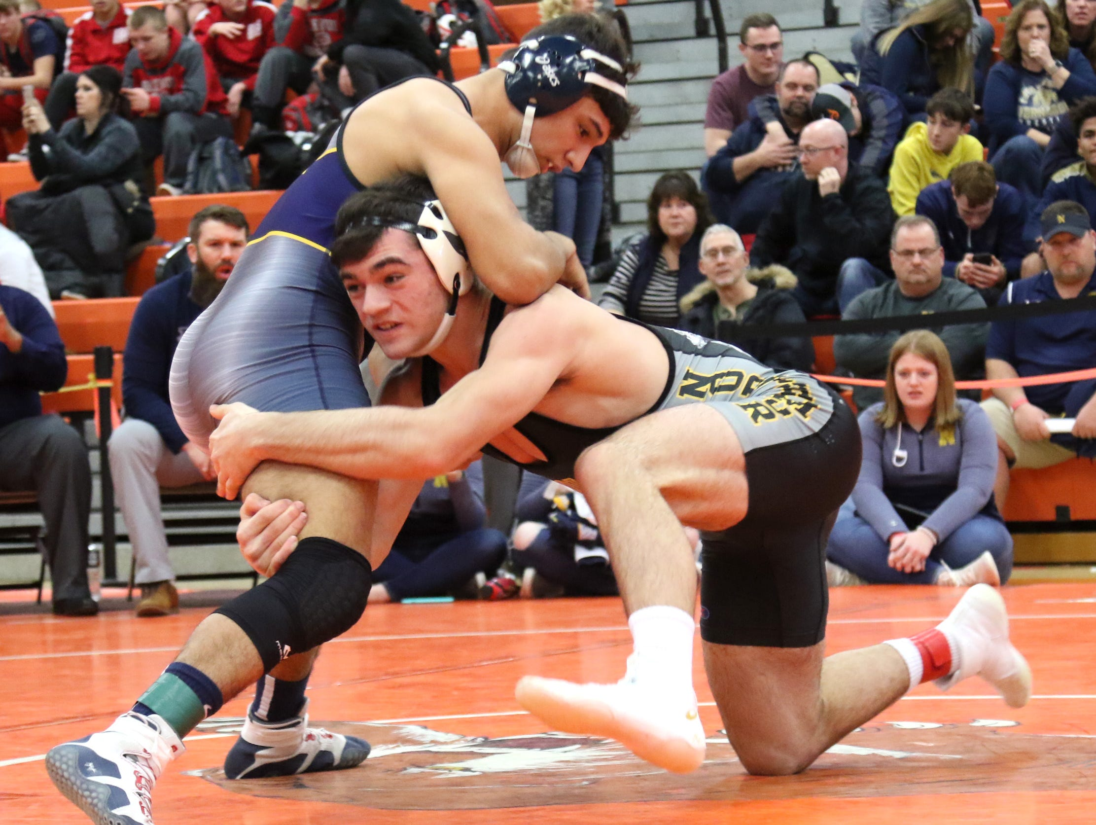 Northmor's Conor Becker spars with Norwalk's Ethan Hernandez during the final matches at the JC Gorman Wrestling Tournament on Saturday.