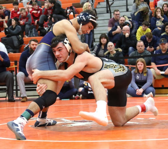 Northmor's Conor Becker (bottom) battles Norwalk's Ethan Hernandez in the 170-pound finals of the 57th J.C. Gorman Invitational earlier this month at Mansfield Senior.