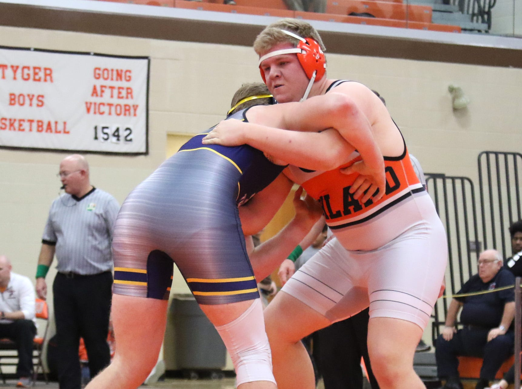 Ashland's Jake Bever spars with Norwalk's Tche Leroux during the final matches at the JC Gorman Wrestling Tournament on Saturday.