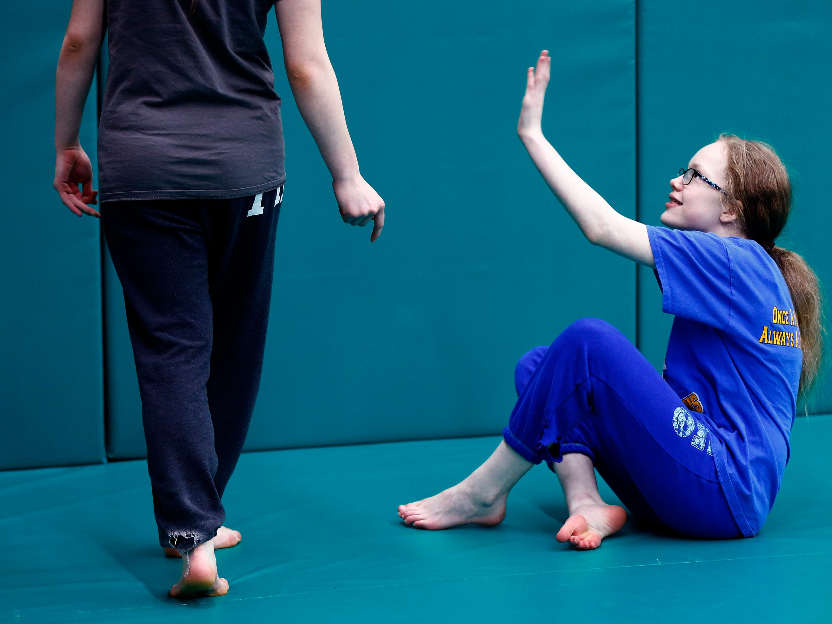Morgan (left) and Maddy Vele of Mukwonago practice what to do if approached while on the ground during a self defense workshop for first-time students at Gracie Jiu-Jitsu Milwaukee in Wauwatosa on Jan. 5.