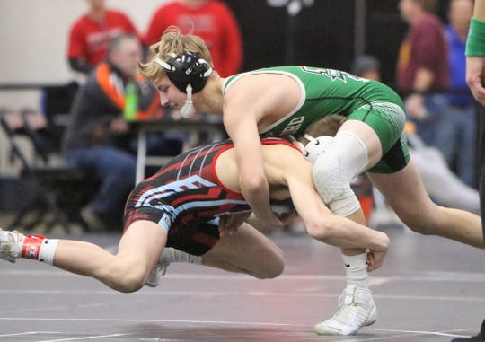 Arrowhead's Mitchell Mesenbrink goes airborne against Waterford's Hayden Halter at the Cheesehead Invitational in Kaukauna on Jan. 5. The two wrestlers faced off in a WIAA state semifinal on Friday.
