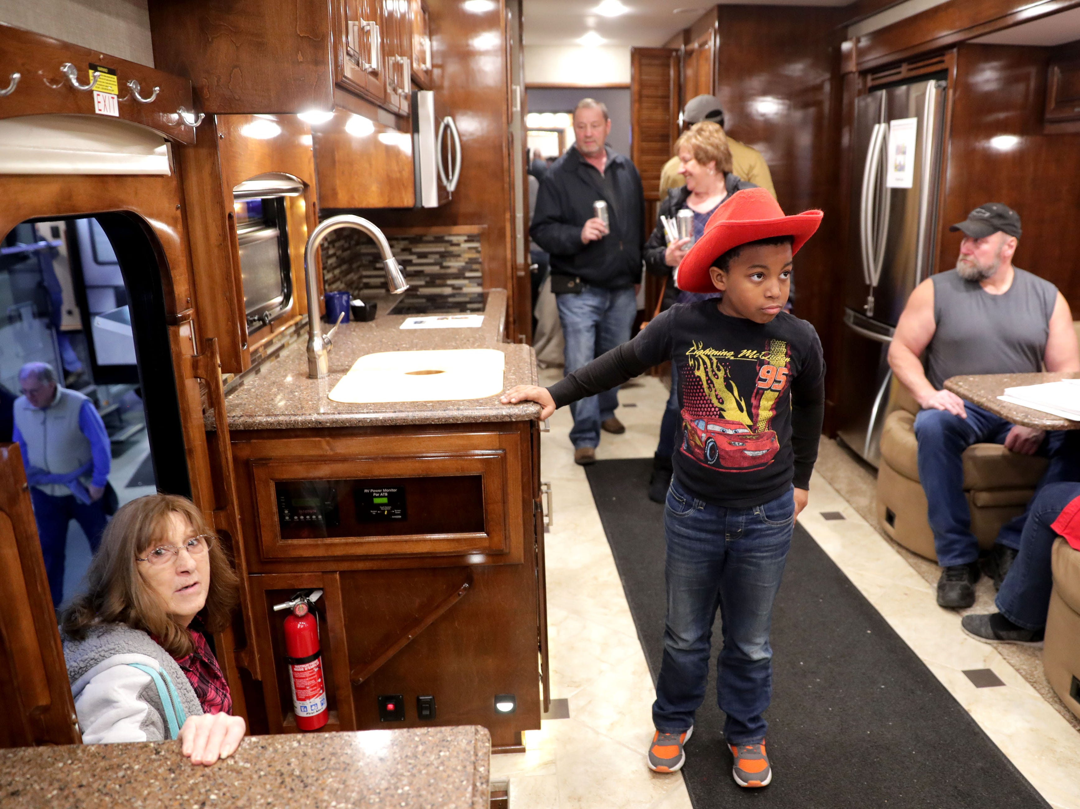 Gabriel Prince, 9, of Milwaukee walks through the 2019 Renegade 45HB Motor Coach. He was with his father, Ted Prince.